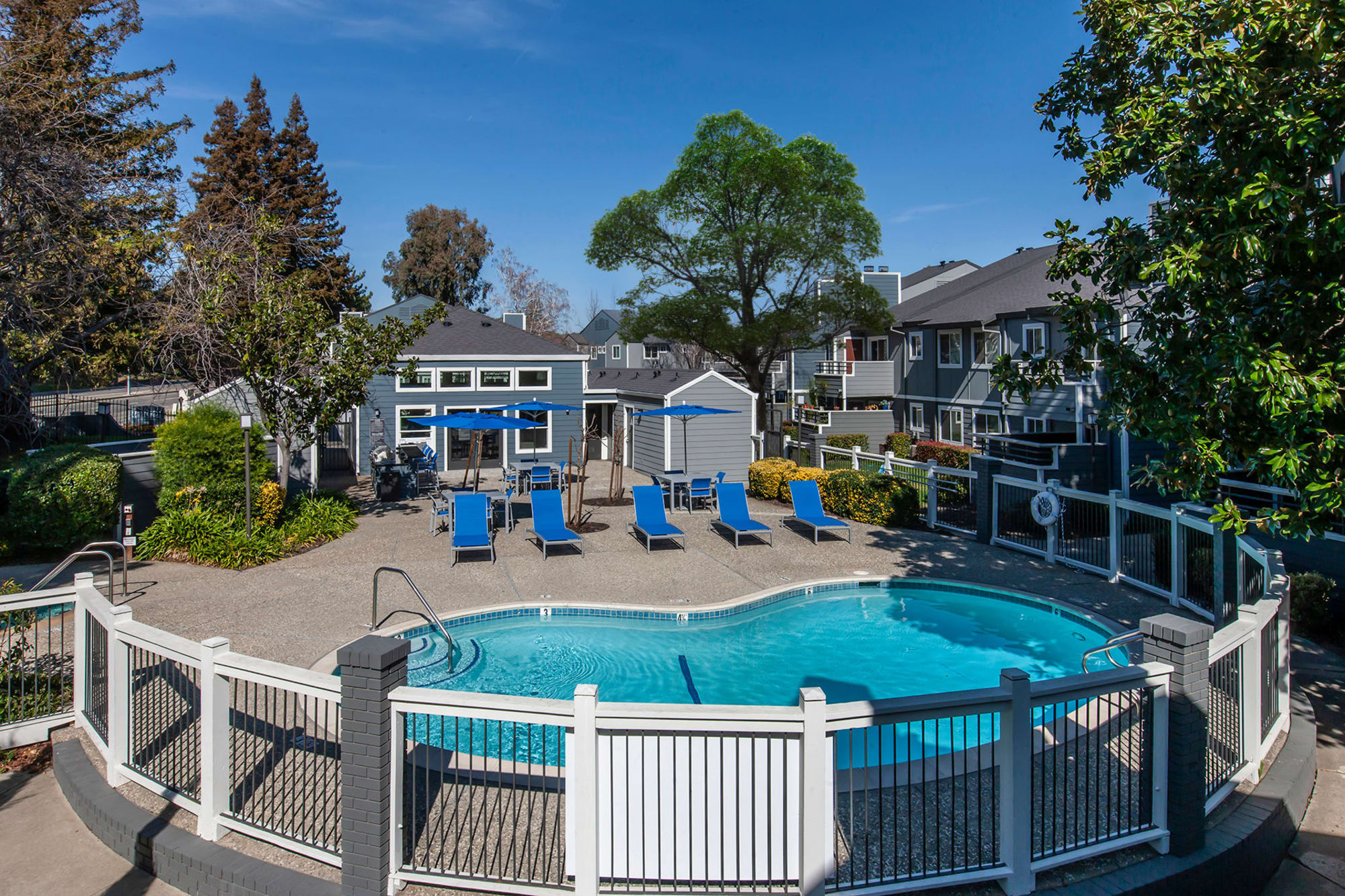 Pool and lounge chairs at Bennington Apartments in Fairfield, California