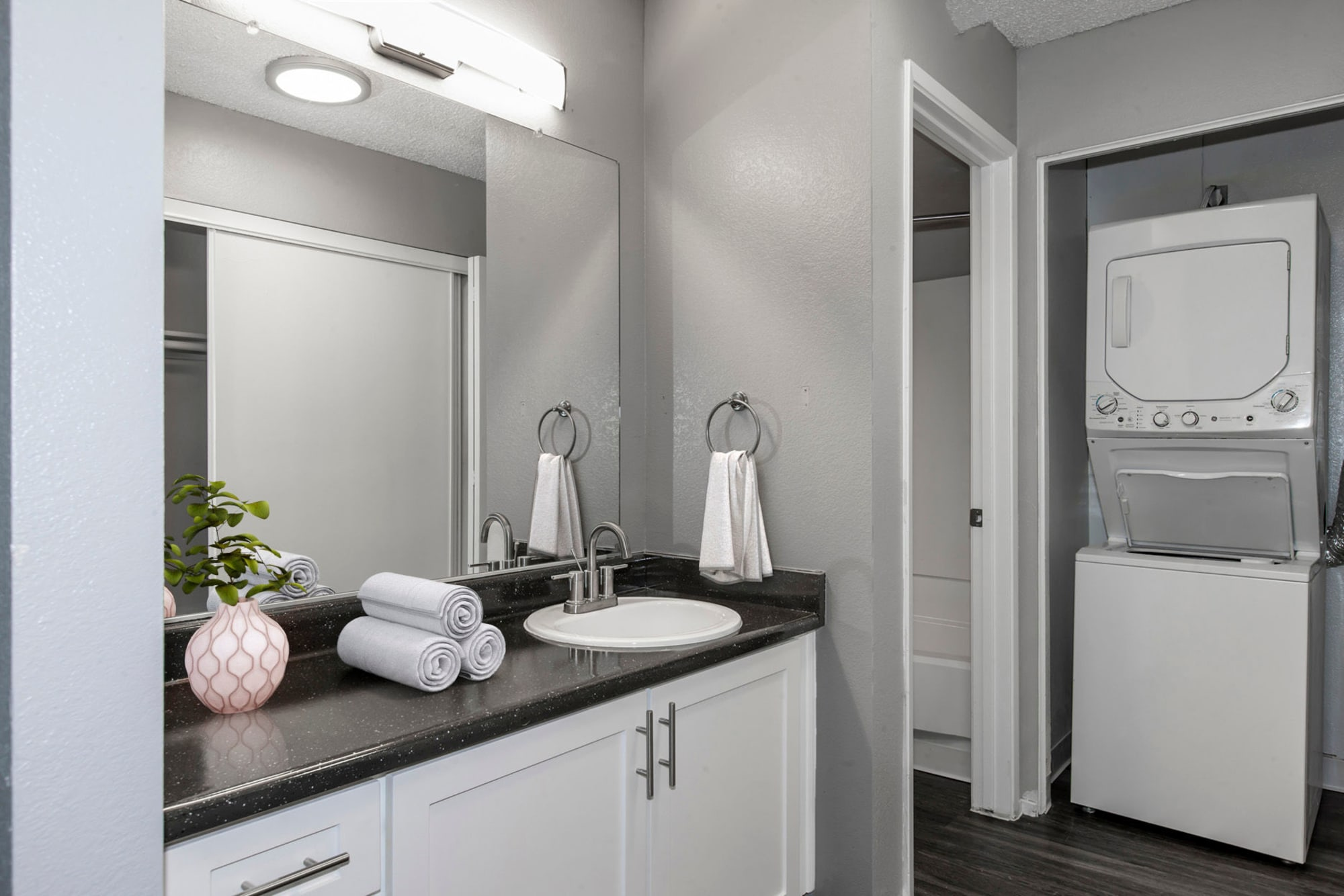 A renovated bathroom with white cabinets at Bennington Apartments in Fairfield, California