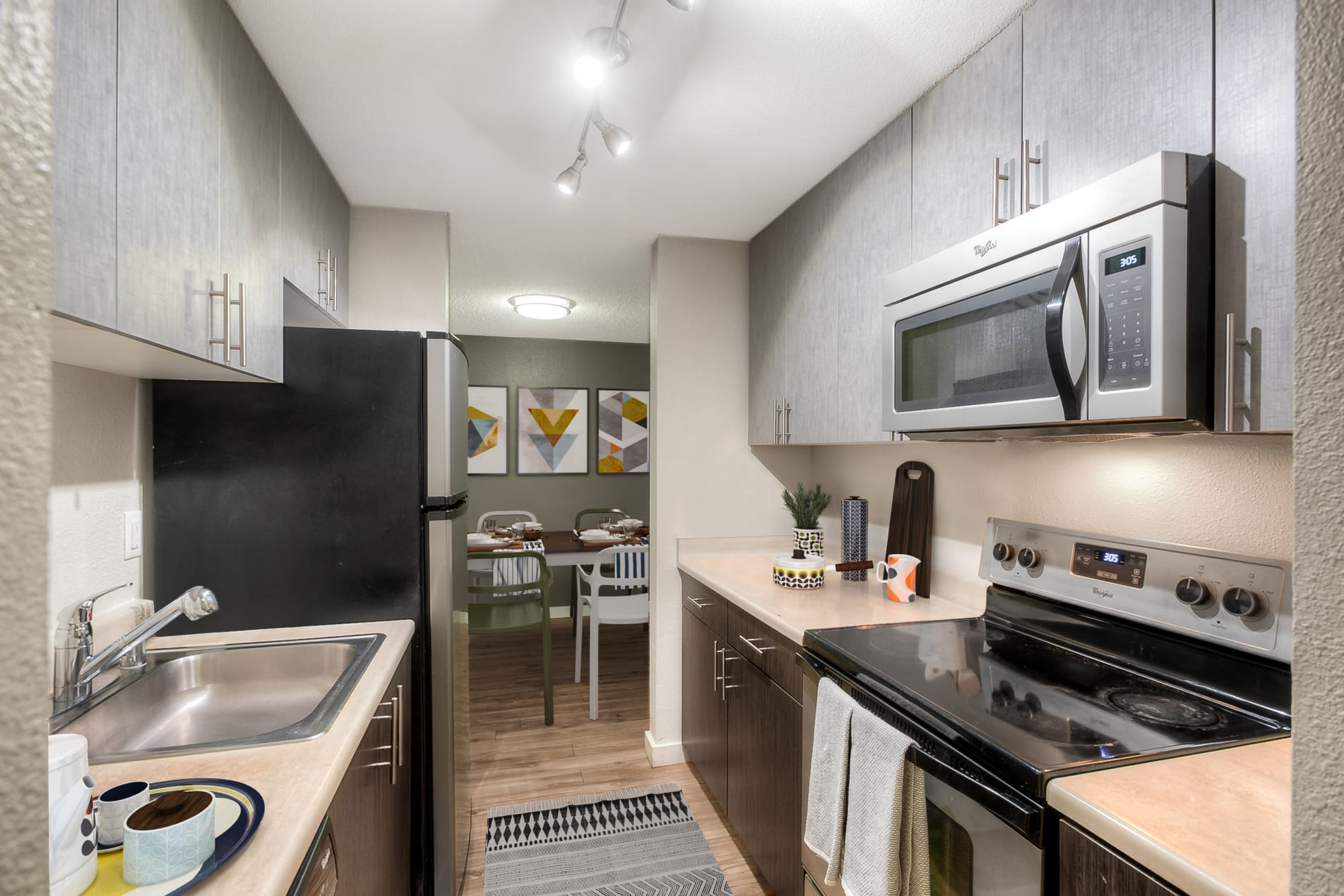 Renovated kitchen with stainless steel appliances at Karbon Apartments in Newcastle, Washington