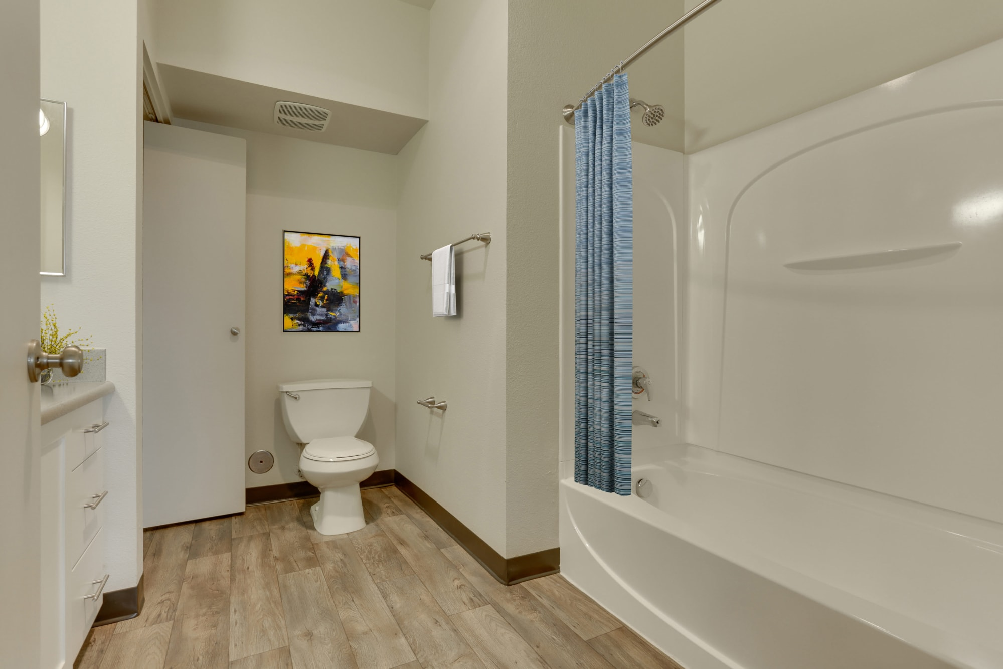 Bathroom with white cabinetry at The Landings at Morrison Apartments in Gresham, Oregon