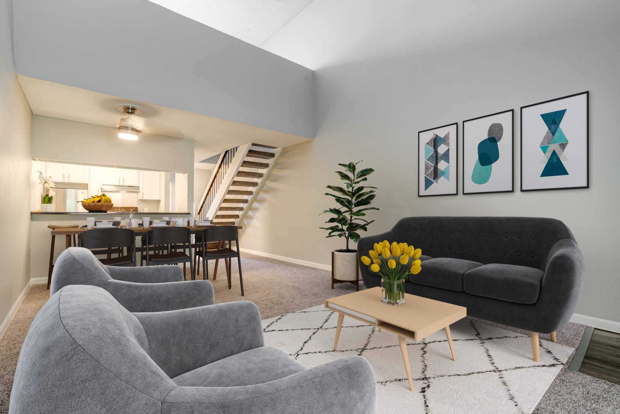 Open floor plan living room and kitchen at The Timbers Apartments in Hayward, California