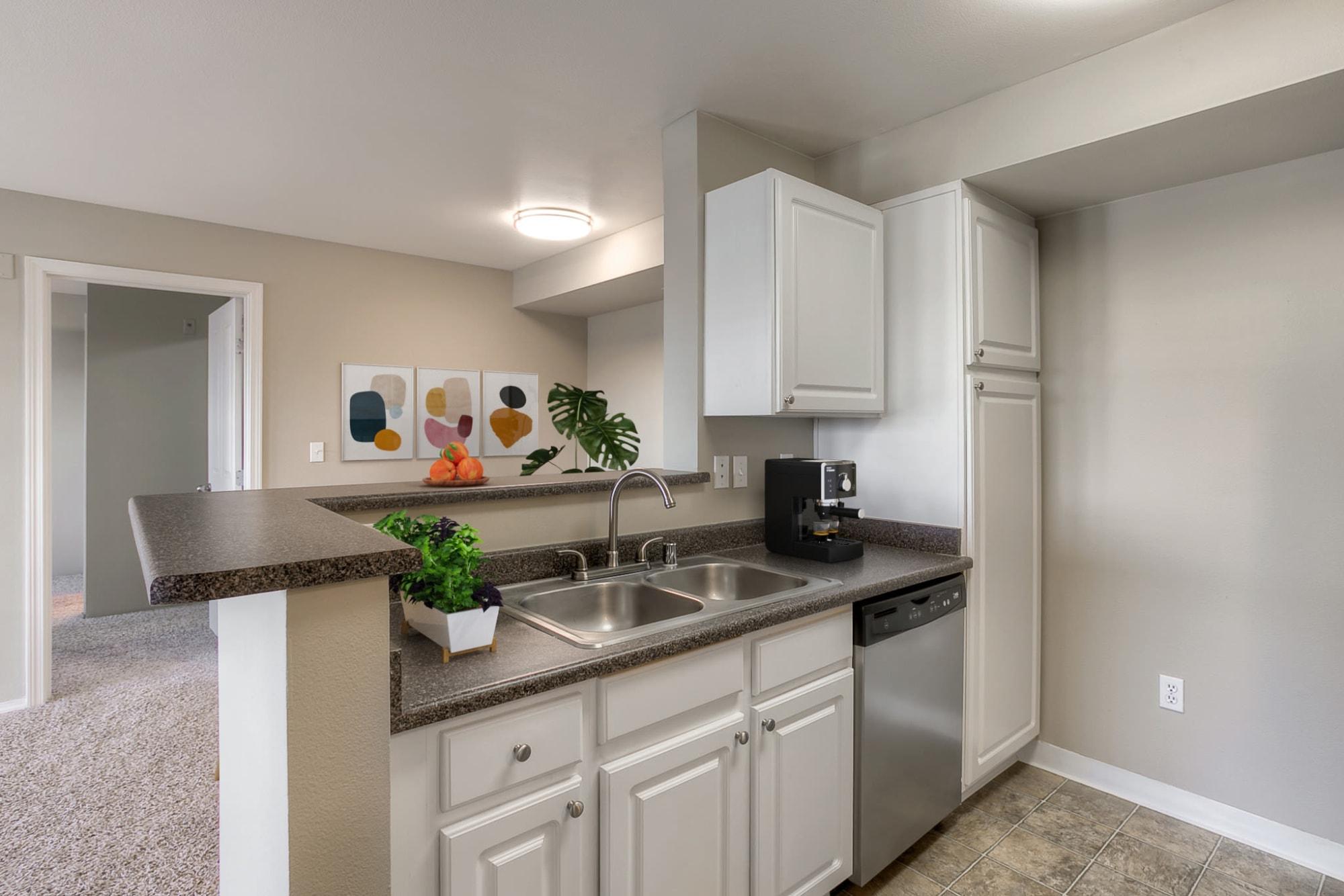 Kitchen, open floor plan at Pebble Cove Apartments in Renton