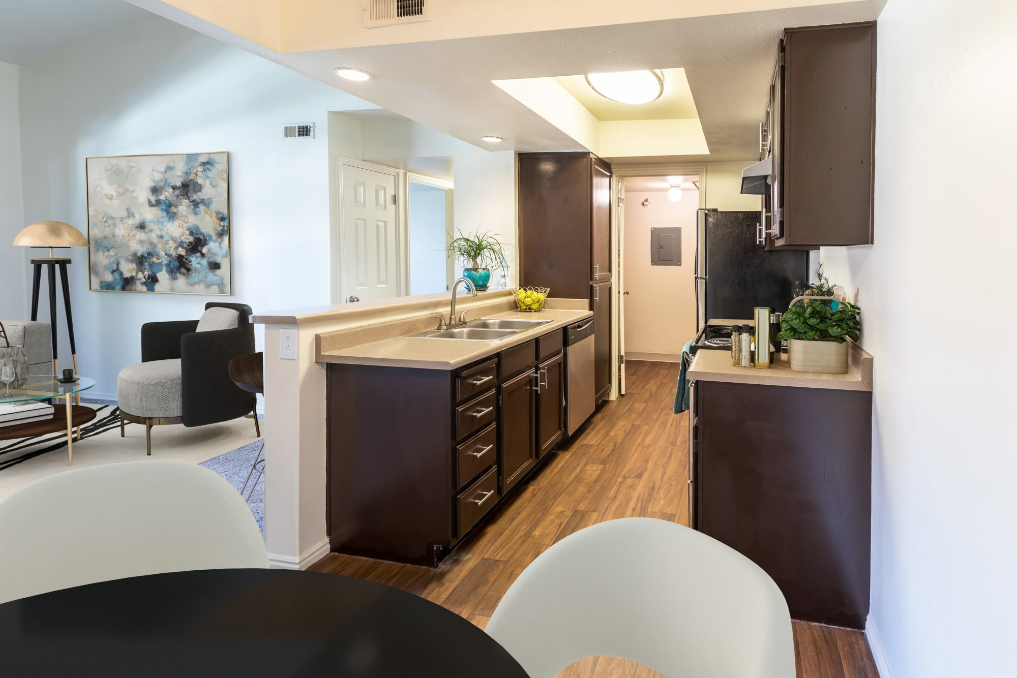 Spacious kitchen with a view into the living room at Shadowbrook Apartments in West Valley City, Utah