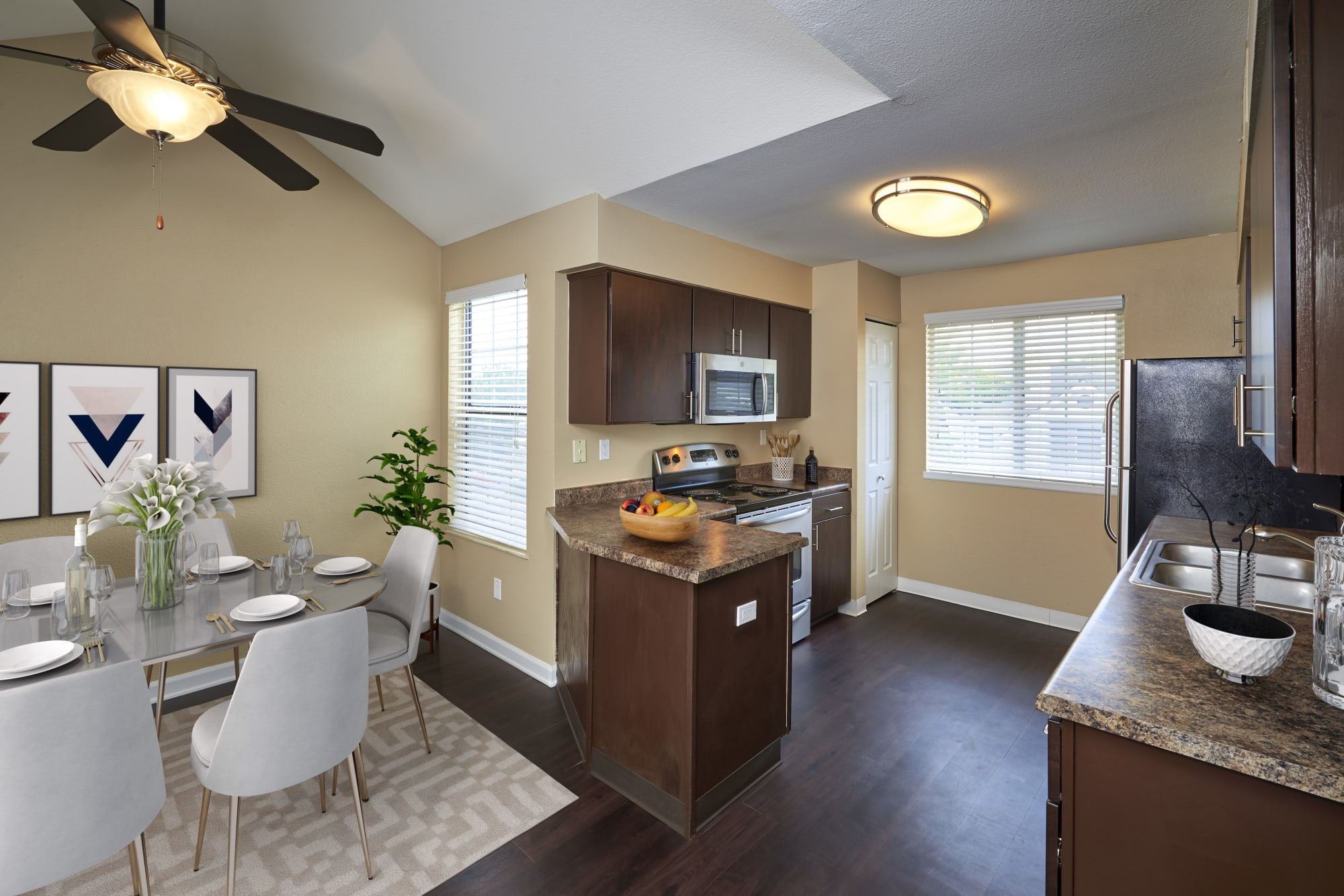 Renovated kitchen with brown cabinets at Villas at Homestead Apartments in Englewood, Colorado