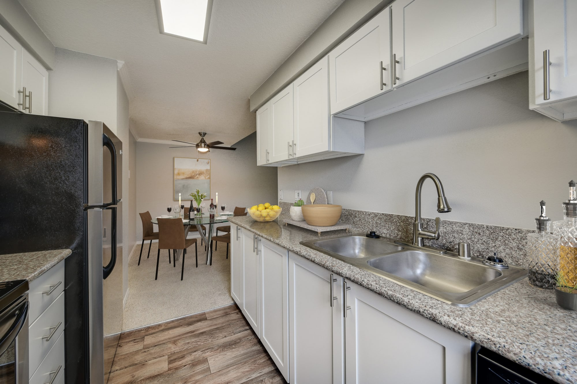 Newly renovated kitchen with white cabinets and stainless steel appliances at Walnut Grove Landing Apartments in Vancouver, Washington