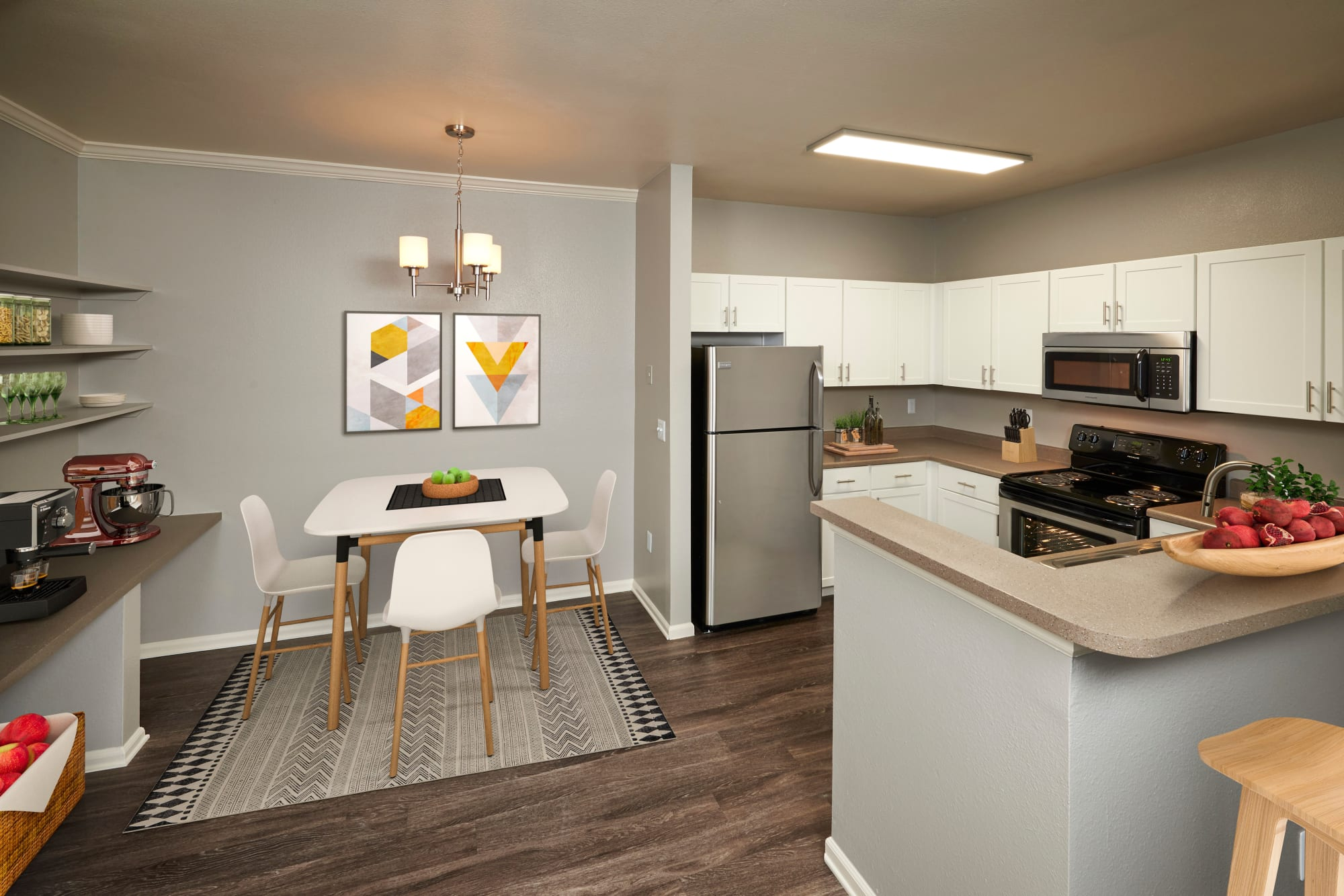 Newly renovated home with white kitchen cabinetry and stainless steel appliances at Westridge Apartments in Aurora, Colorado