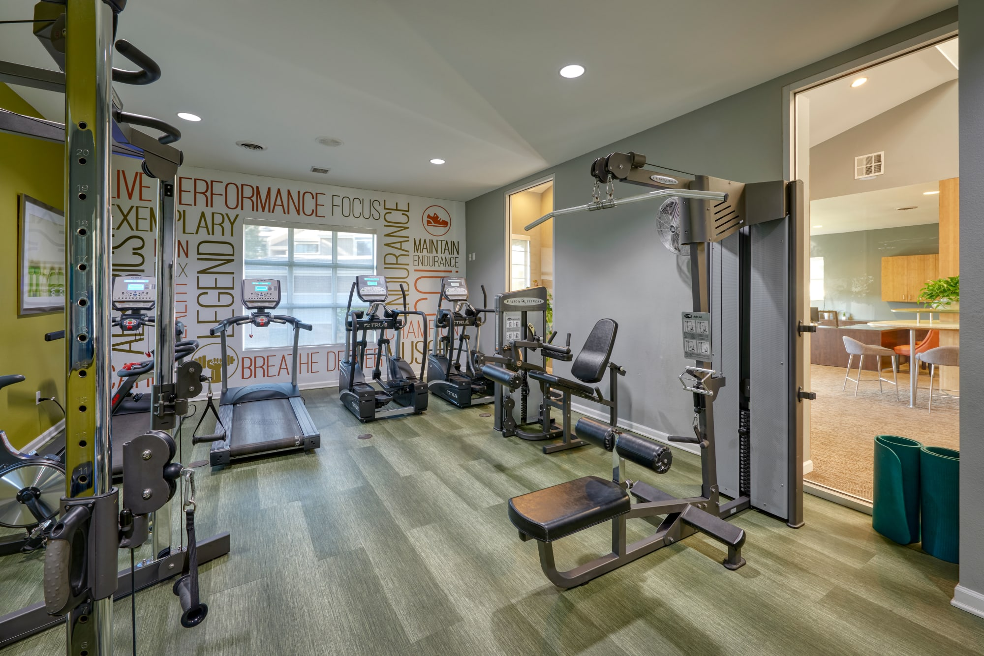 The fully equipped fitness center at Alton Green Apartments in Denver, Colorado