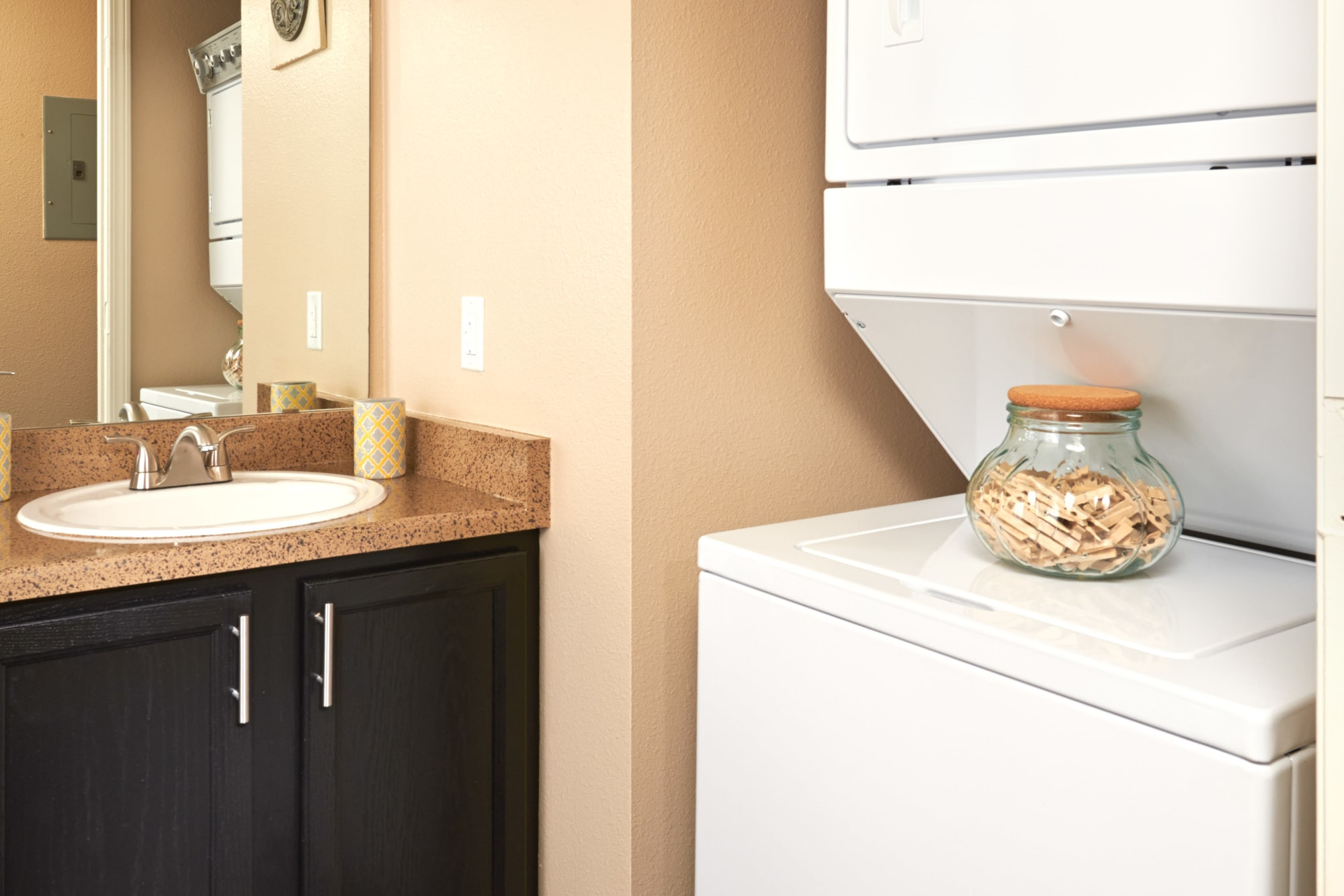 Stackable washer and dryer at Crossroads at City Center Apartments in Aurora, Colorado