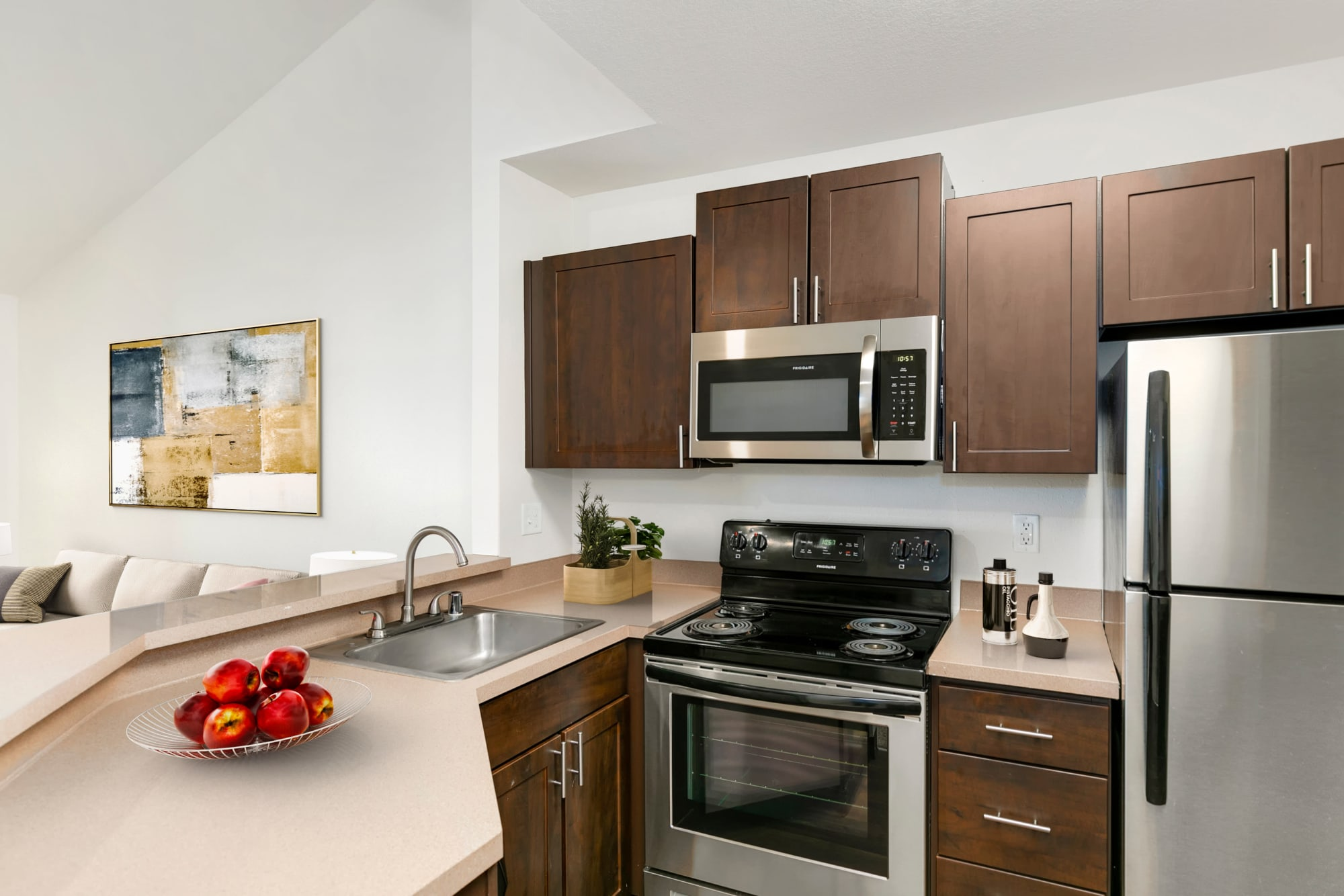 Updated kitchen with espresso cabinets at Autumn Chase Apartments in Vancouver, Washington