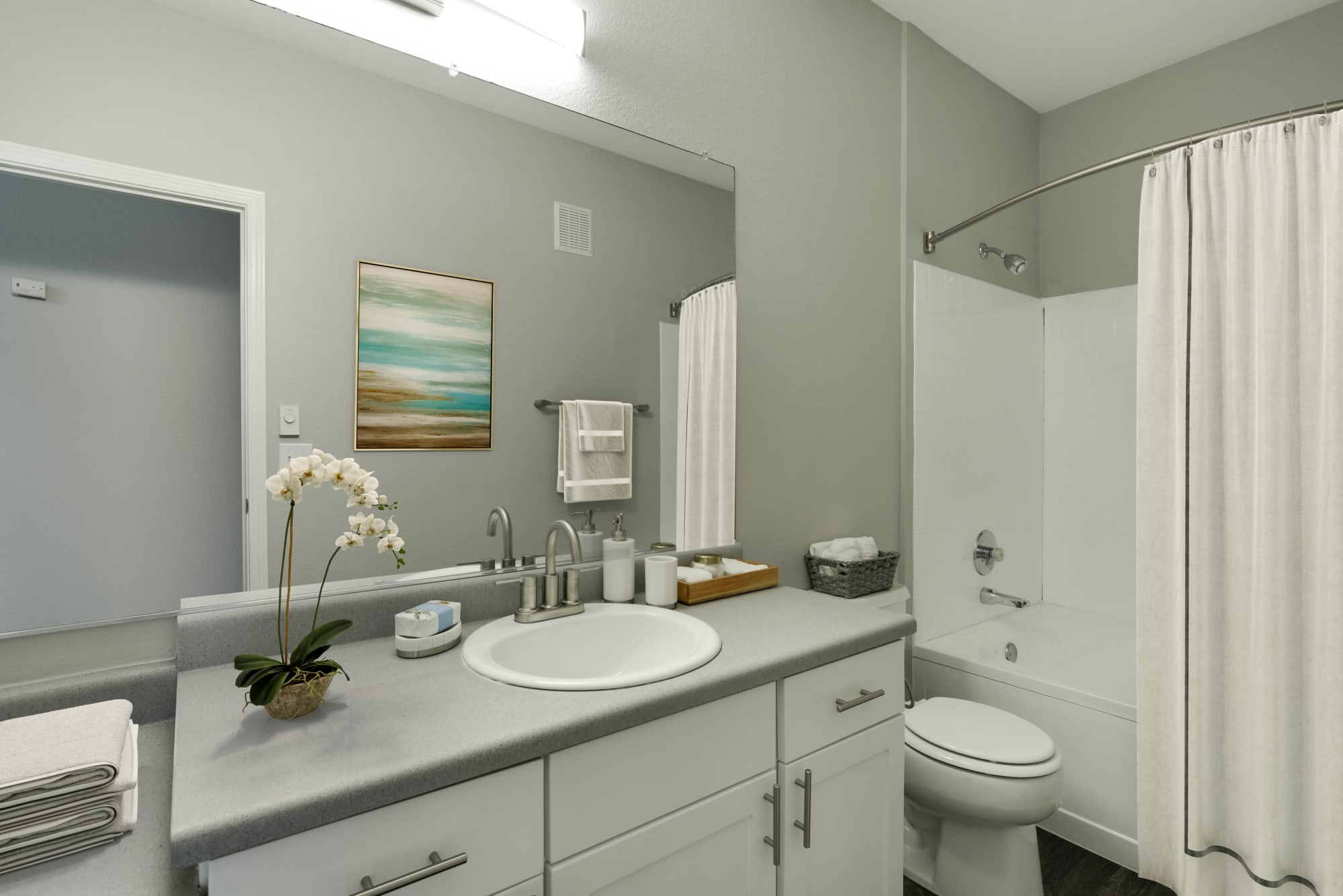 Renovated bathroom with white cabinets at The Grove at Orenco Station in Hillsboro, Oregon