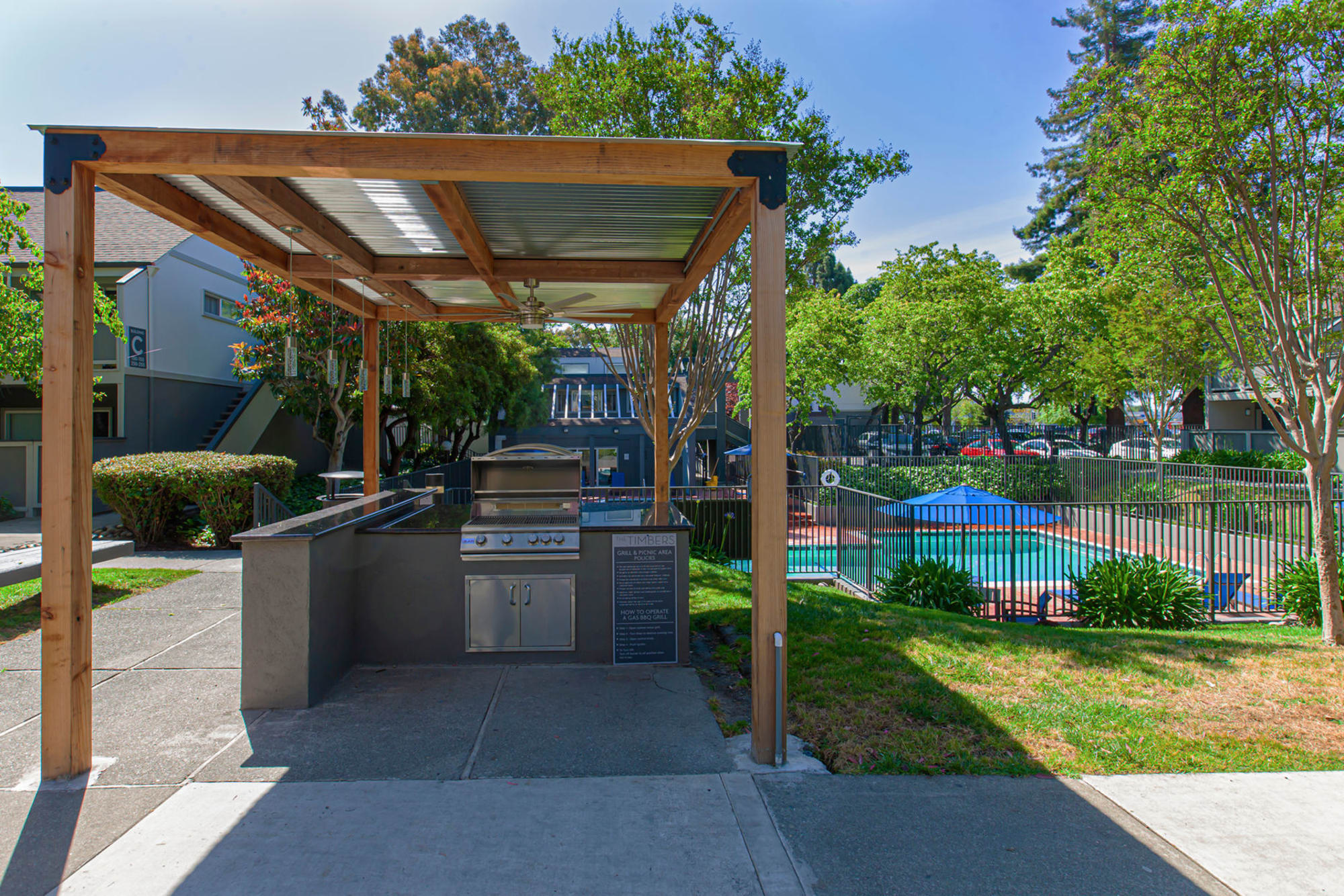 Outdoor Covered BBQ atThe Timbers Apartments in Hayward, CA