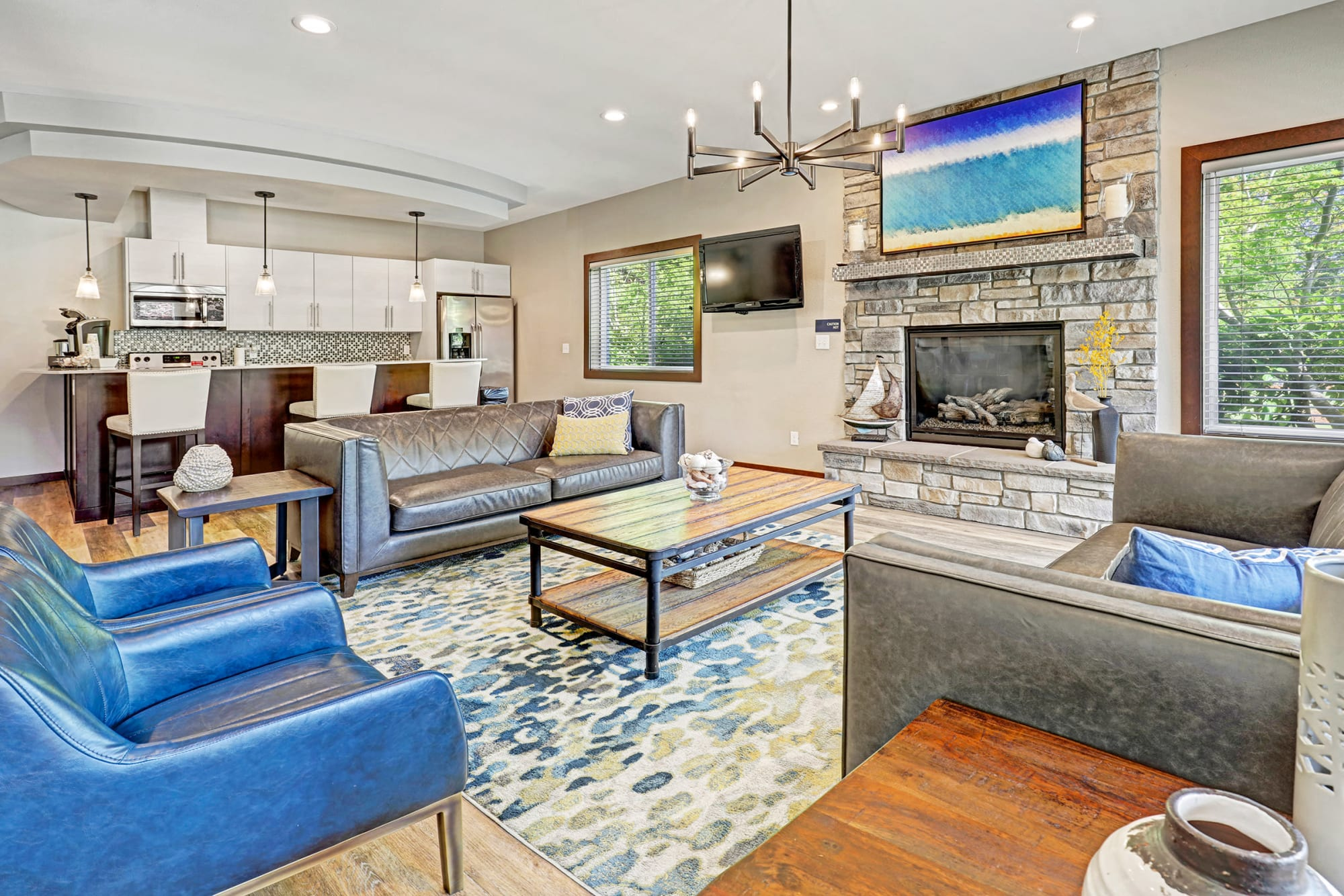The clubhouse with plenty of seating and a flat screen television at Cascade Ridge in Silverdale, Washington