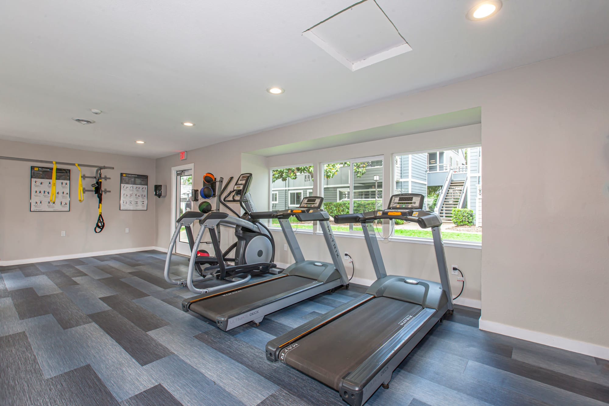 Exercise machines in the recently renovated fitness center at Bennington Apartments in Fairfield, California