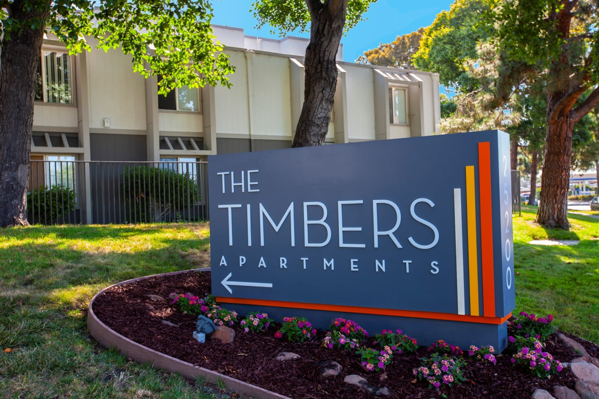 Monument sign at The Timbers Apartments in Hayward, California