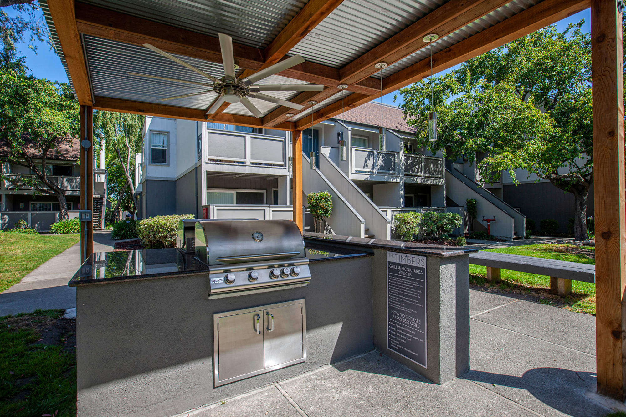 Outdoor covered BBQ area at The Timbers Apartments in Hayward, California