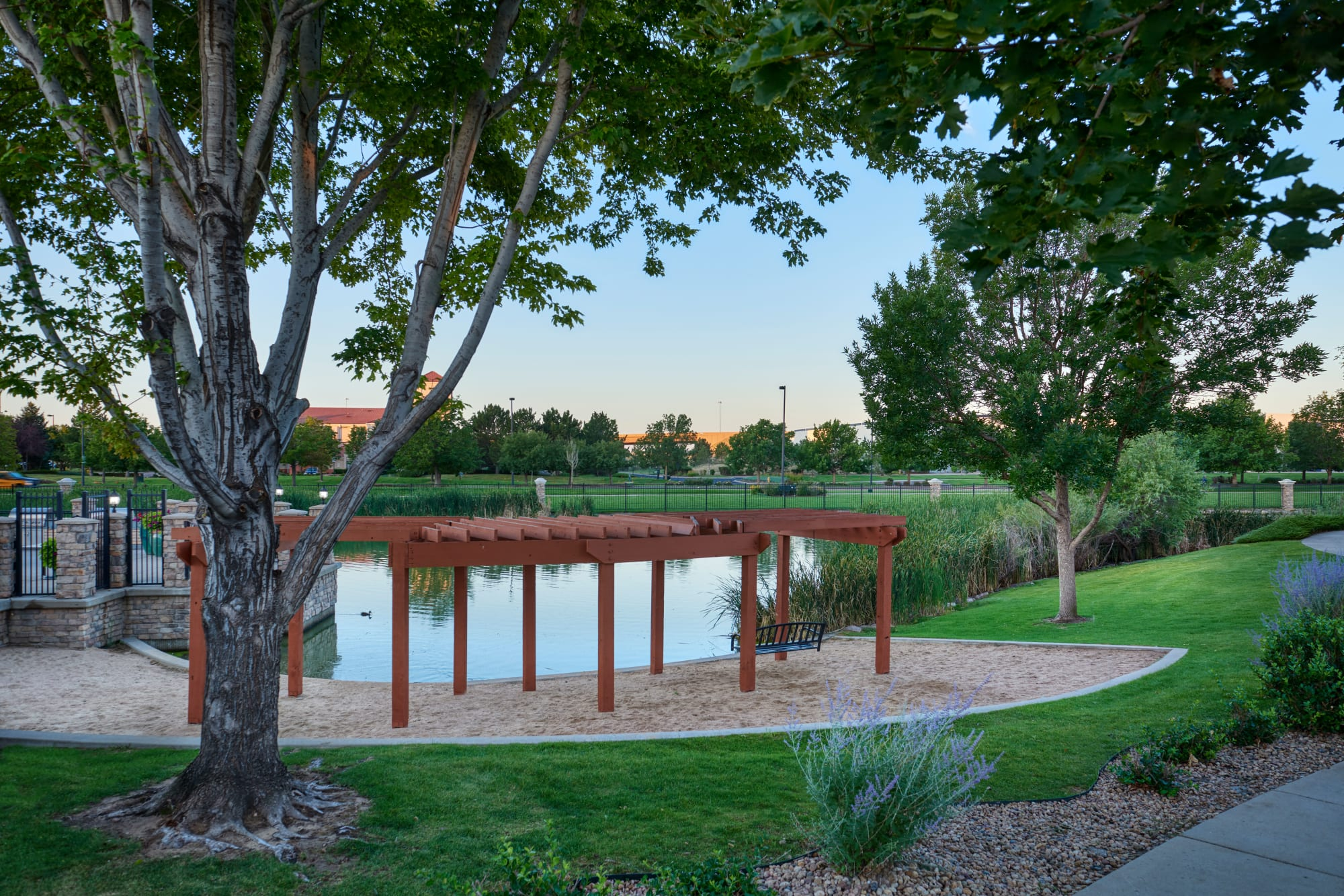 The lakeside swings on the beach at Gateway Park Apartments in Denver, Colorado