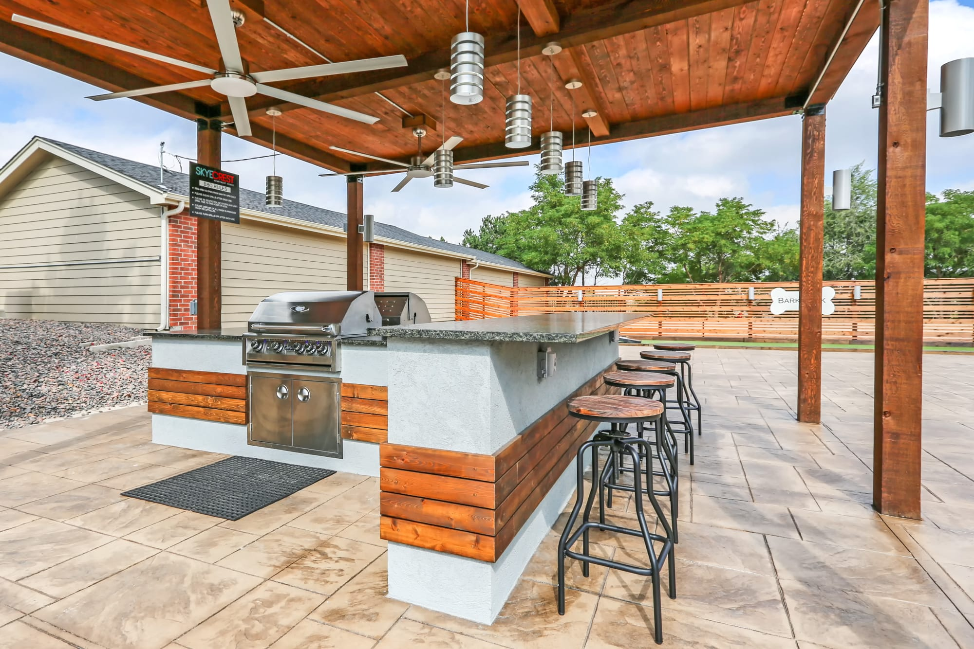Covered BBQ with bar top seating at Skyecrest Apartments in Lakewood, Colorado