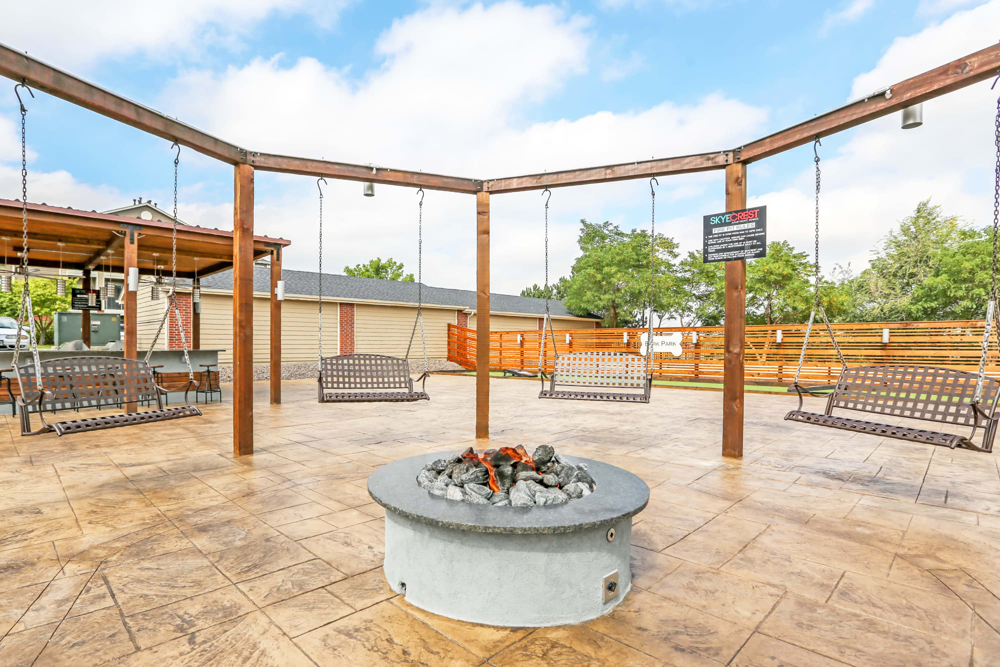 Fire pit and swing seating at Skyecrest Apartments in Lakewood, Colorado