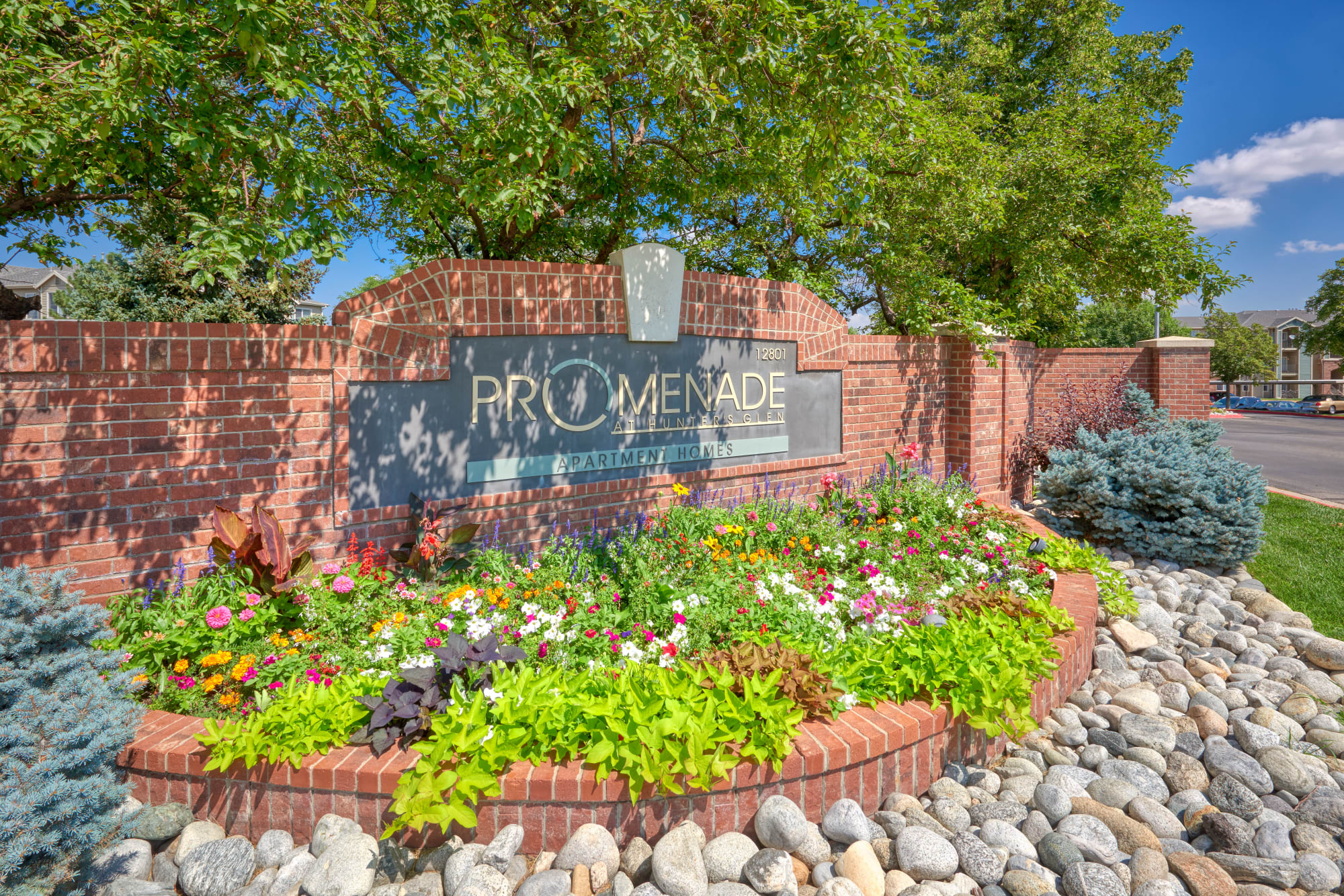 Monument sign at Promenade at Hunter's Glen Apartments in Thornton, Colorado