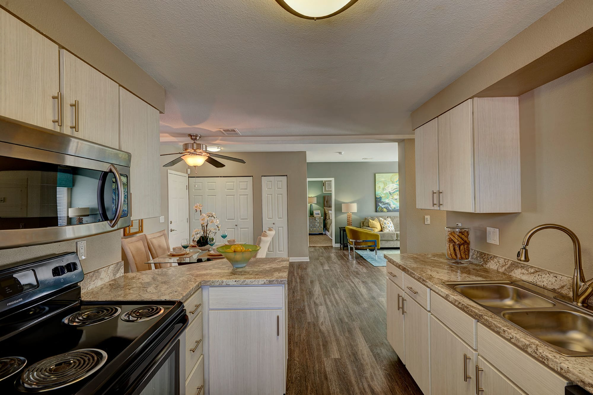 Well organized kitchen in an open floor plan at Villas at Homestead Apartments in Englewood, Colorado