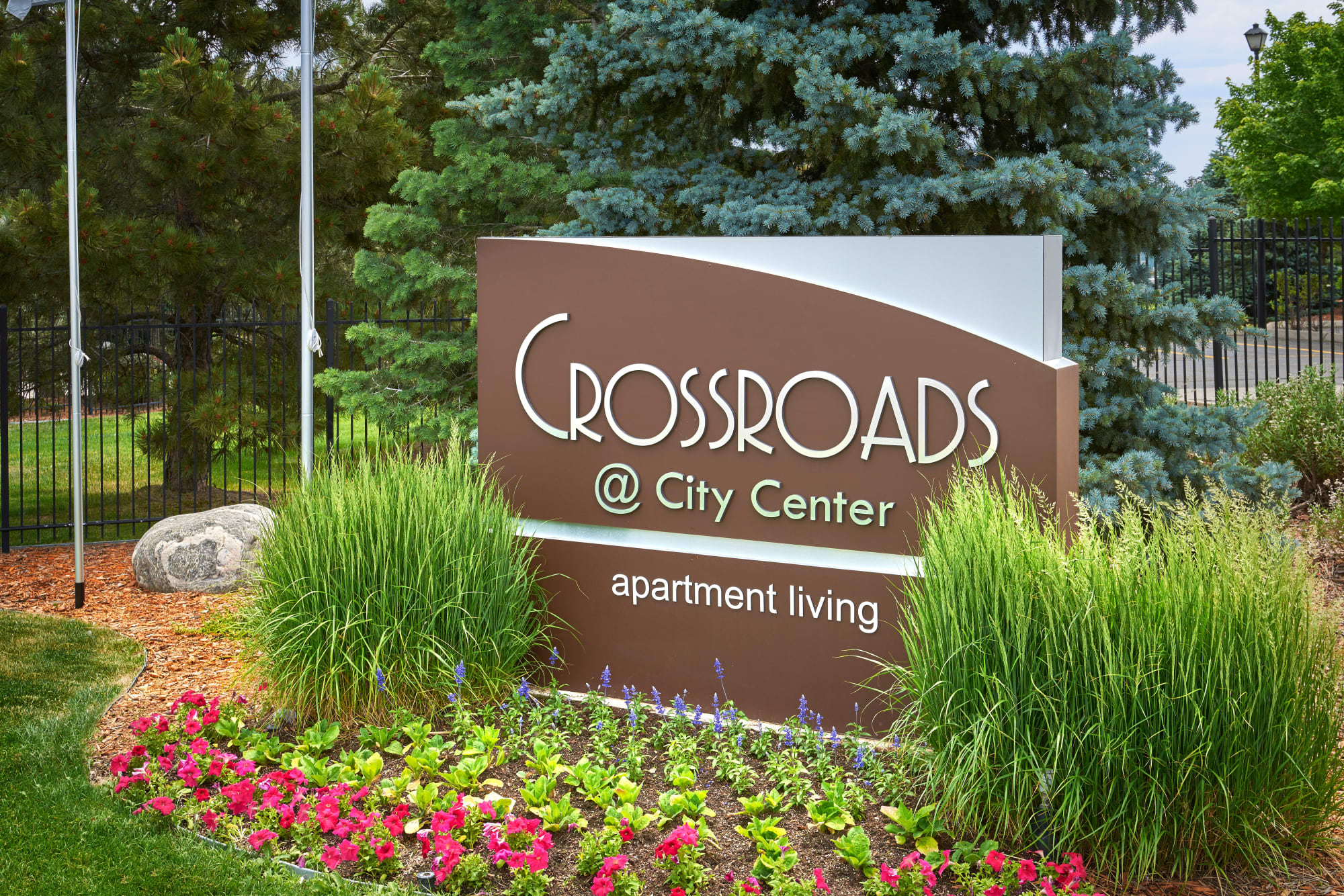 The monument sign at Crossroads at City Center Apartments in Aurora, Colorado