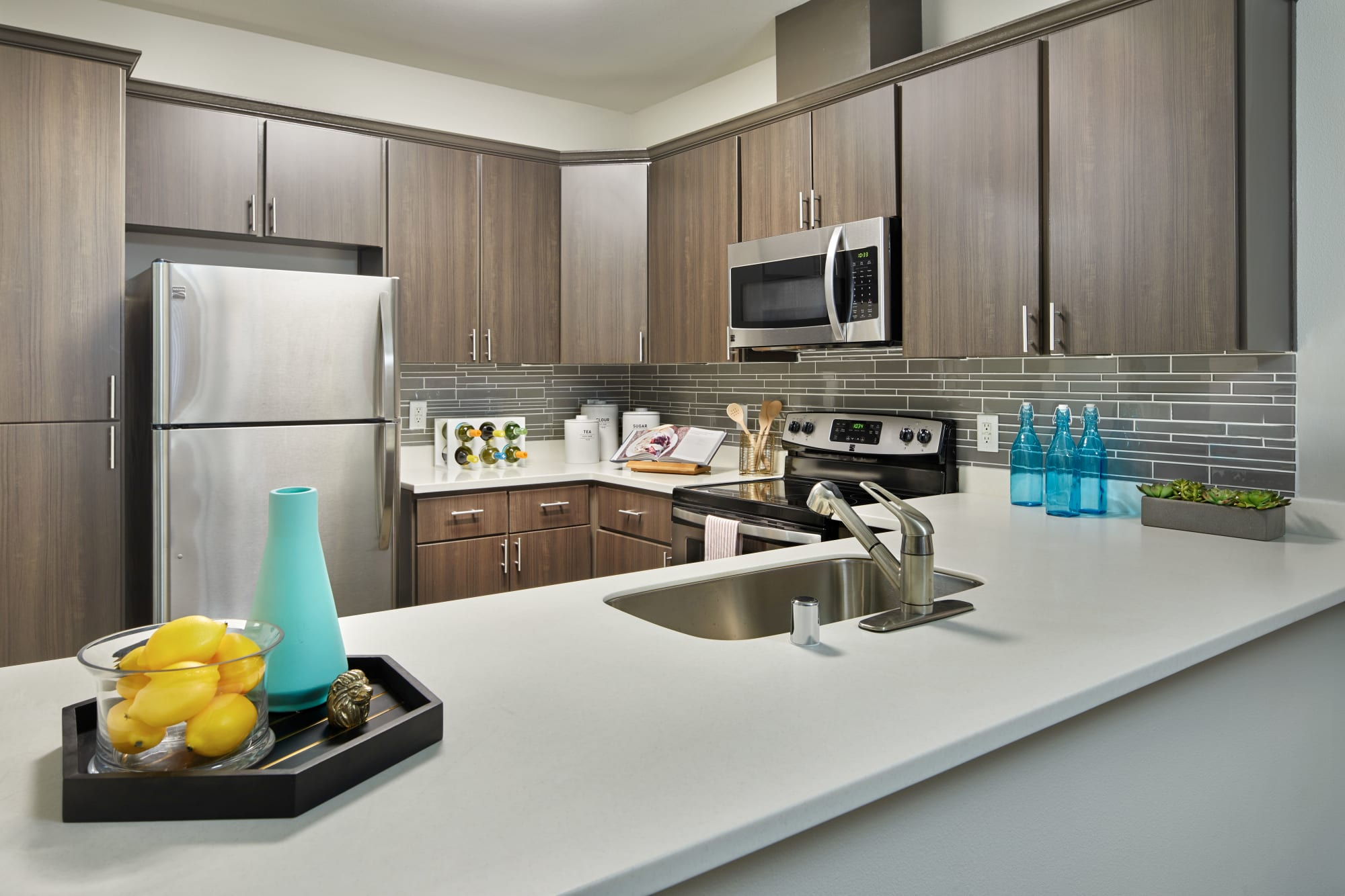 Renovated kitchen with brown cabinets at Brookside Village in Auburn, Washington