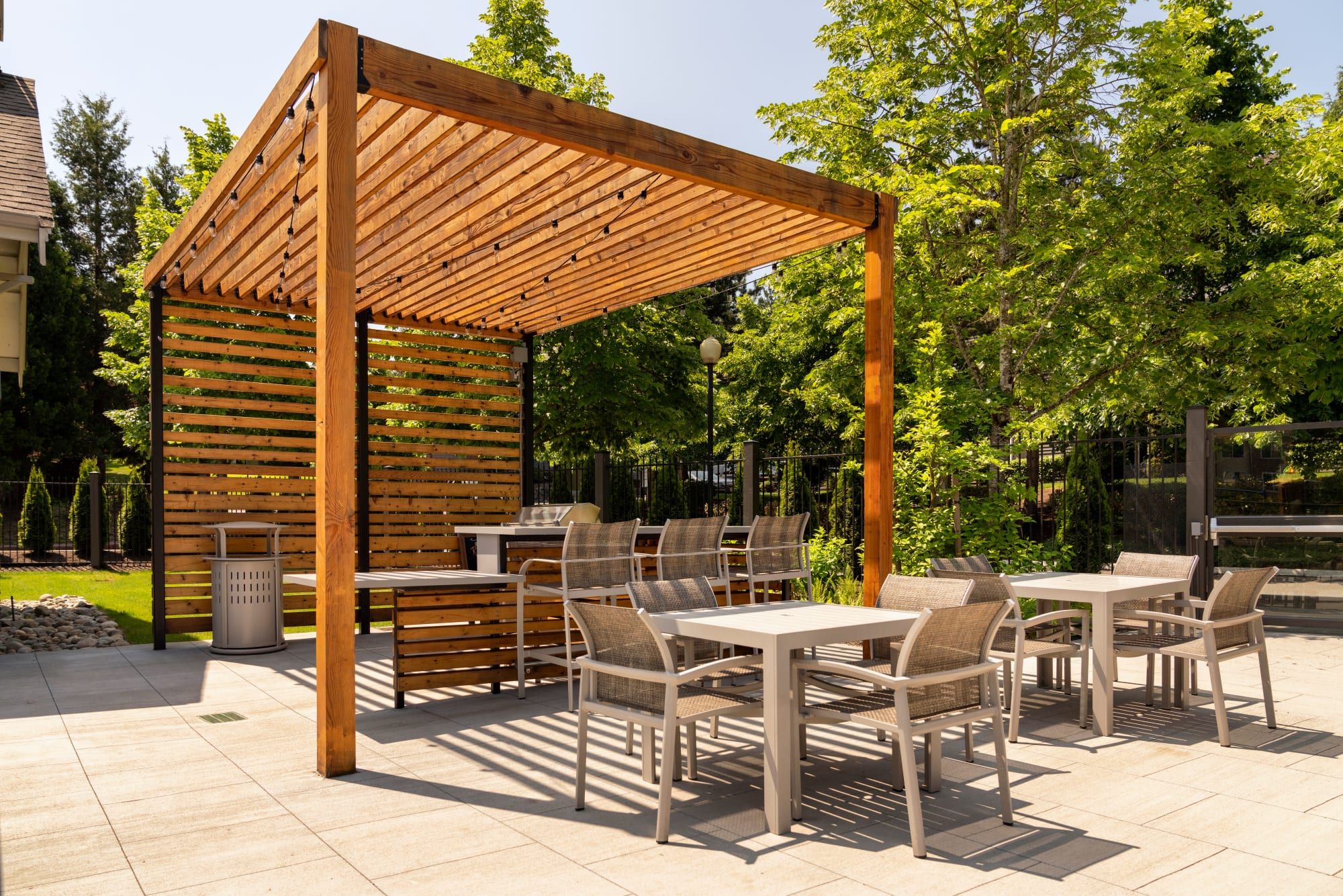 A grilling area and dining tables at Brookside Village in Auburn, Washington
