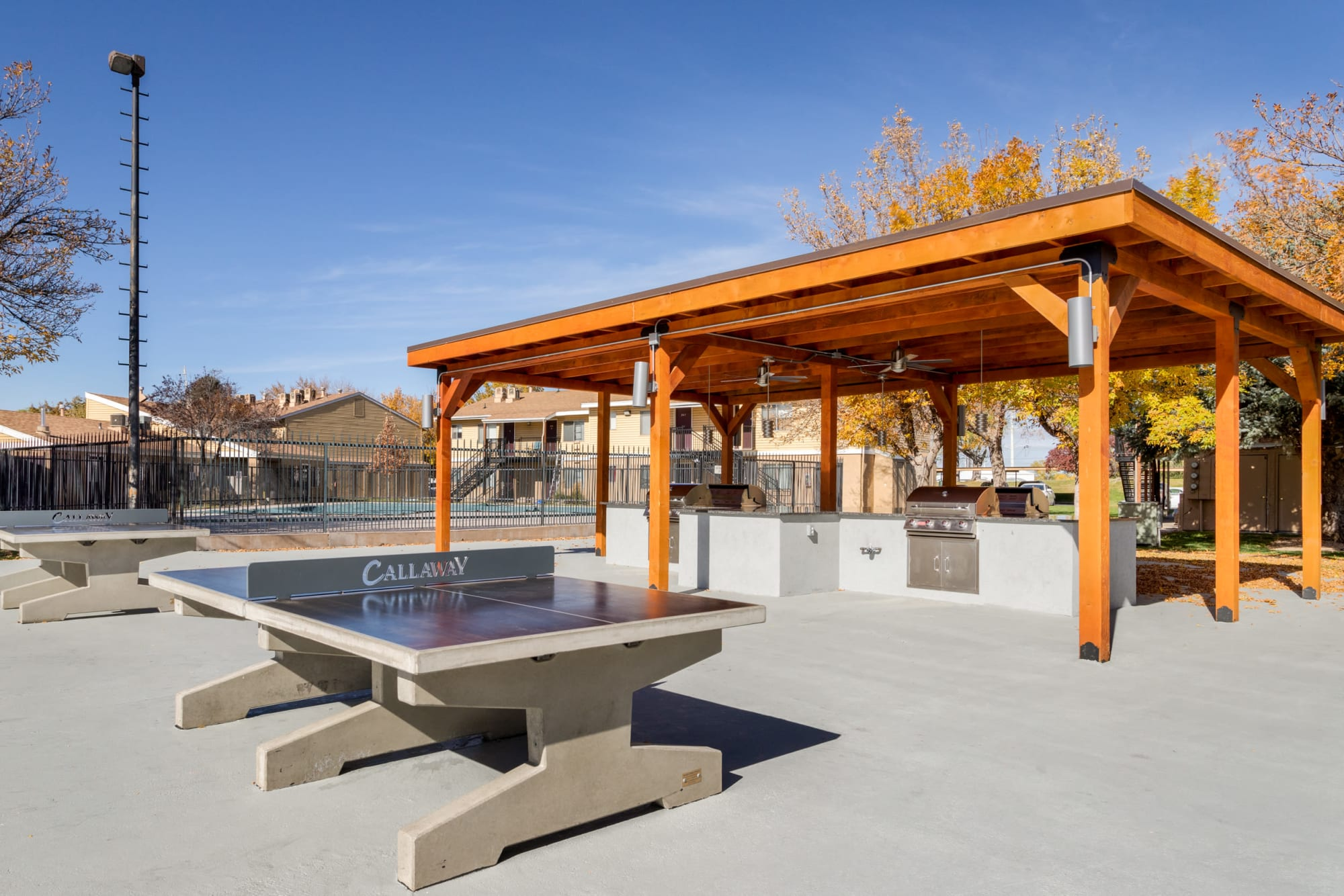 Covered outdoor BBQ Pavillion and ping-pong  at Callaway Apartments in Taylorsville, Utah