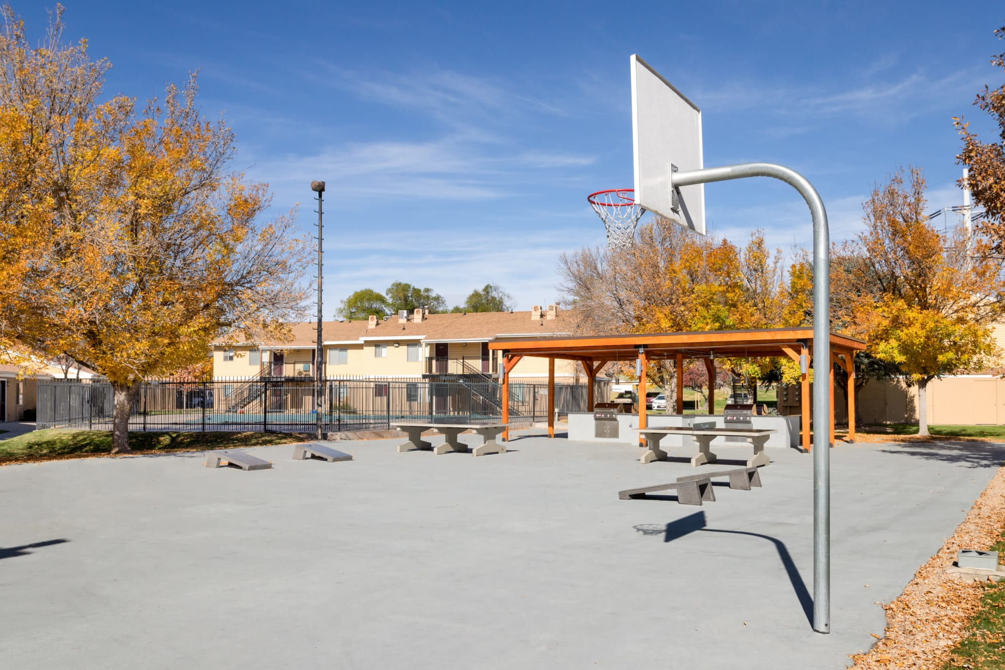 Multi-purpose sports court with Basketball, corn hole, and ping-pong at Callaway Apartments in Taylorsville, Utah