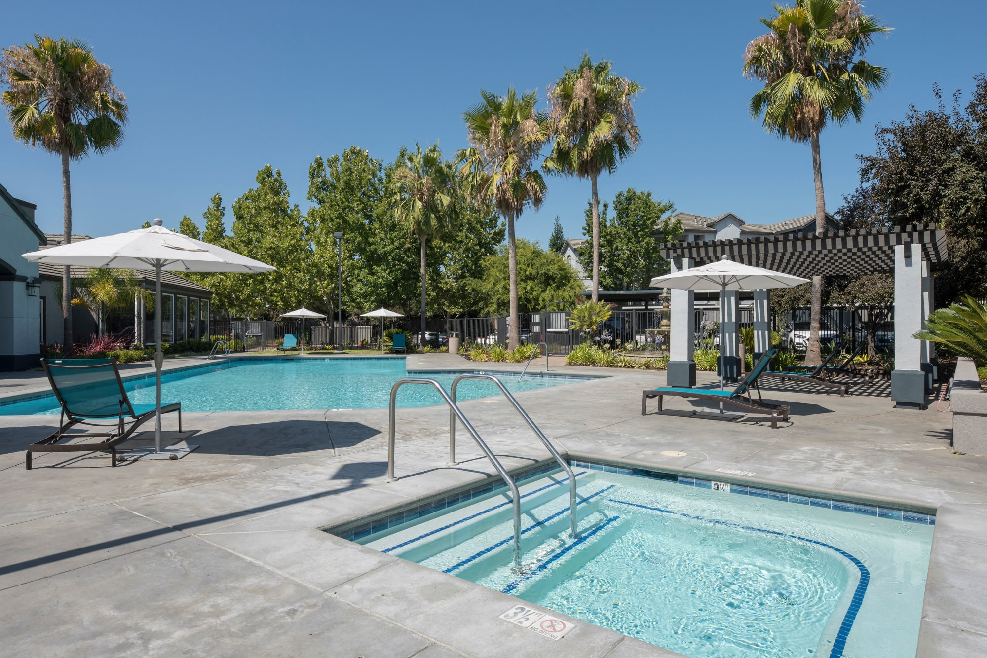 Hot tub and swimming pool at Avion Apartments in Rancho Cordova, California