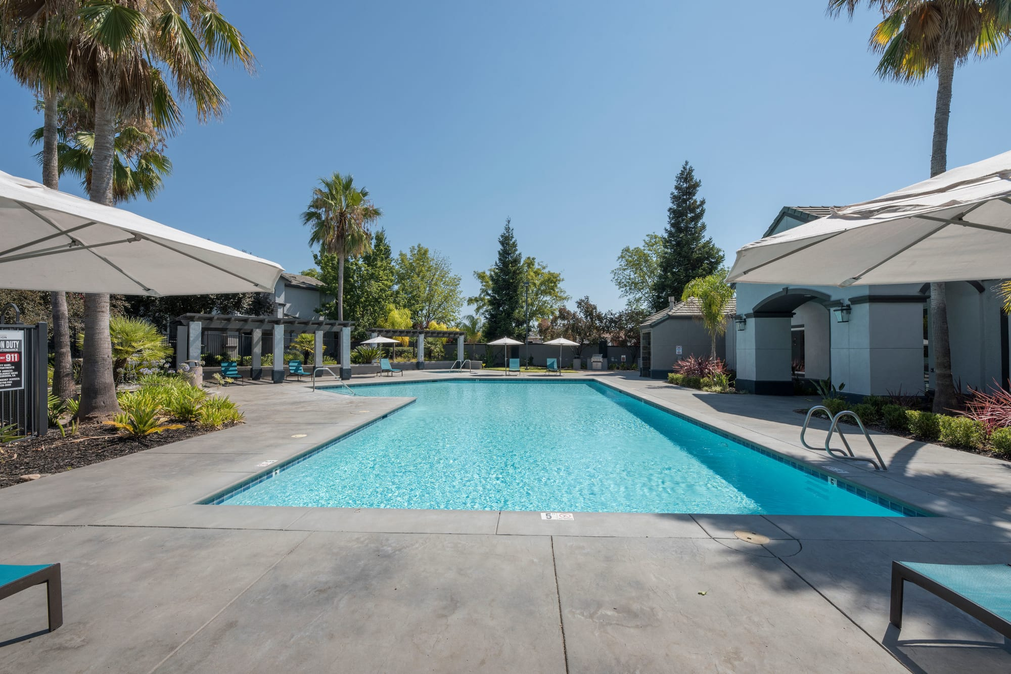 Swimming pool and patio seating at Avion Apartments in Rancho Cordova, California