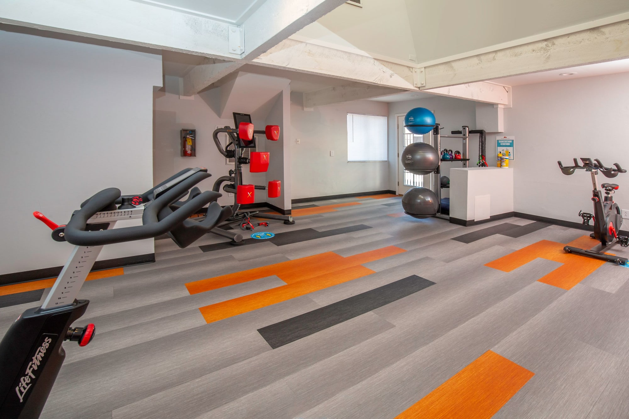 Newly Renovated Fitness Center with Cardio Machines at Shadowbrook Apartments in West Valley City, Utah