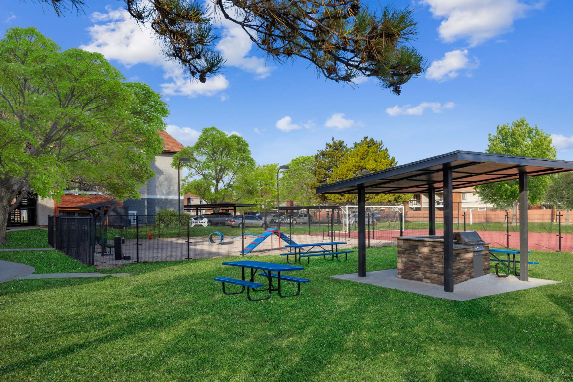 Covered BBQ and picnic area and Dog Park at Shadowbrook Apartments in West Valley City, Utah