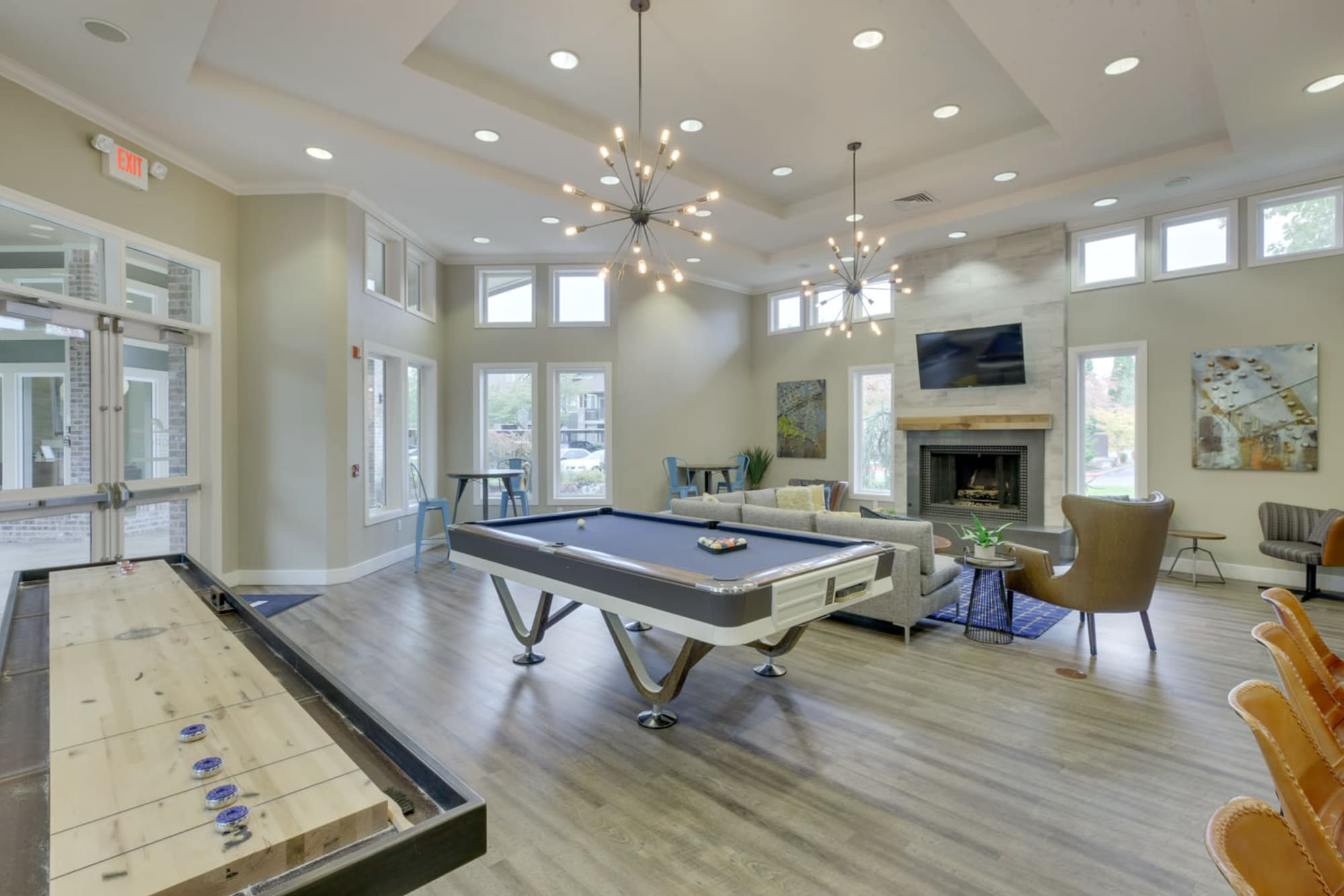 The clubhouse pool table on hardwood floors at The Grove at Orenco Station in Hillsboro, Oregon