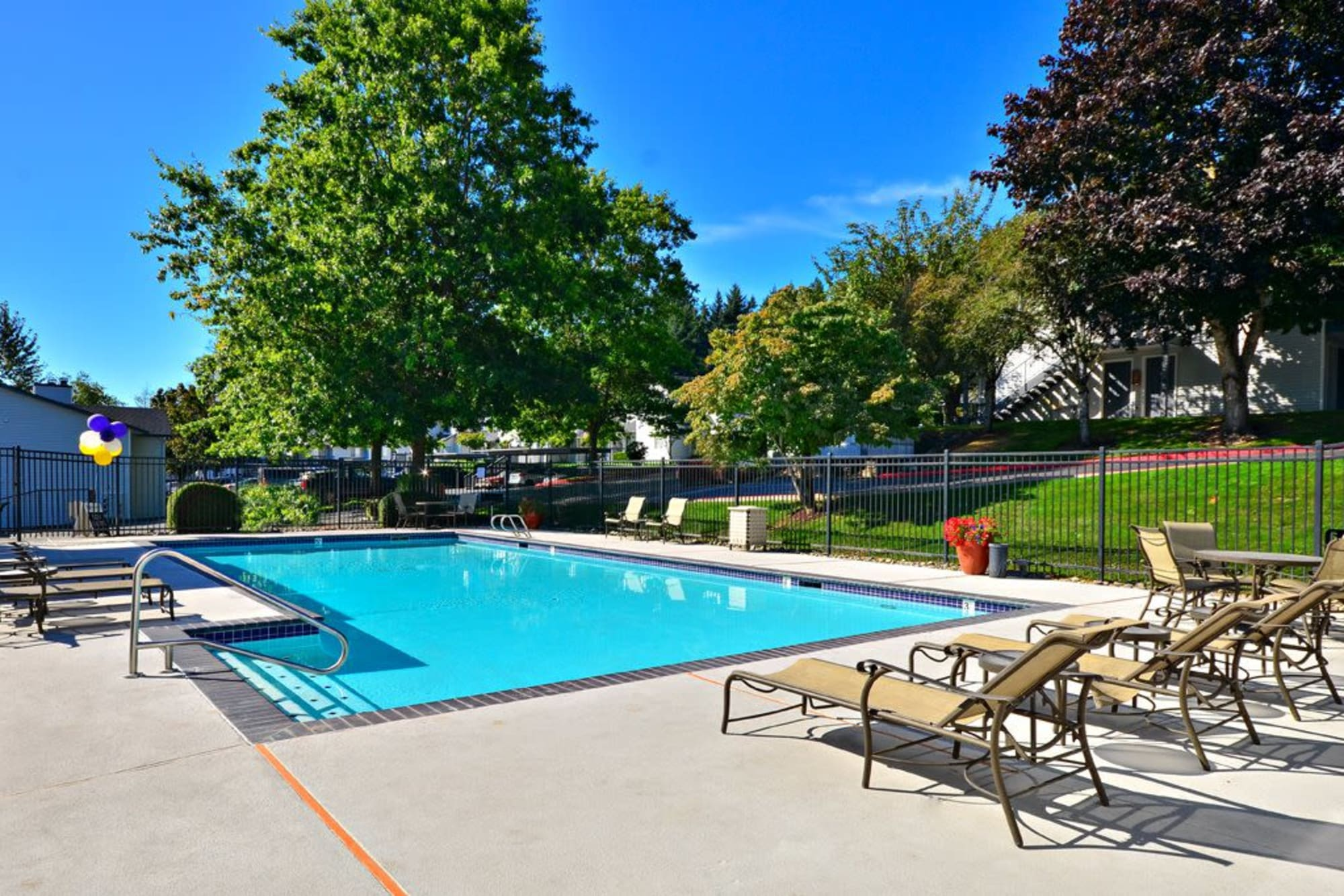 The inviting bright blue swimming pool at Wellington Apartment Homes in Silverdale, Washington