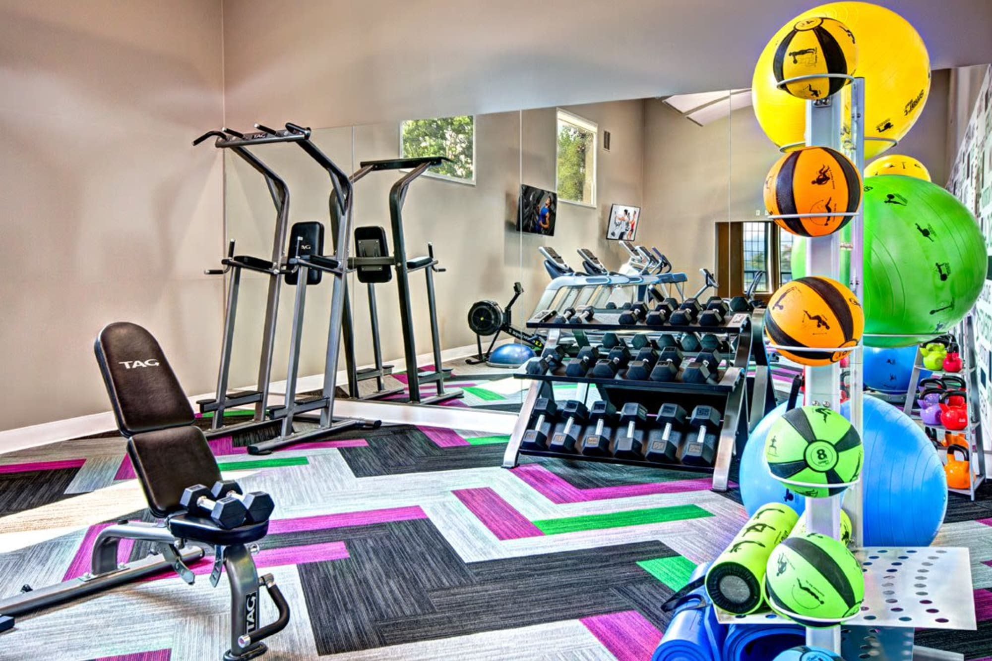 The fully equipped gym at Wellington Apartment Homes in Silverdale, Washington