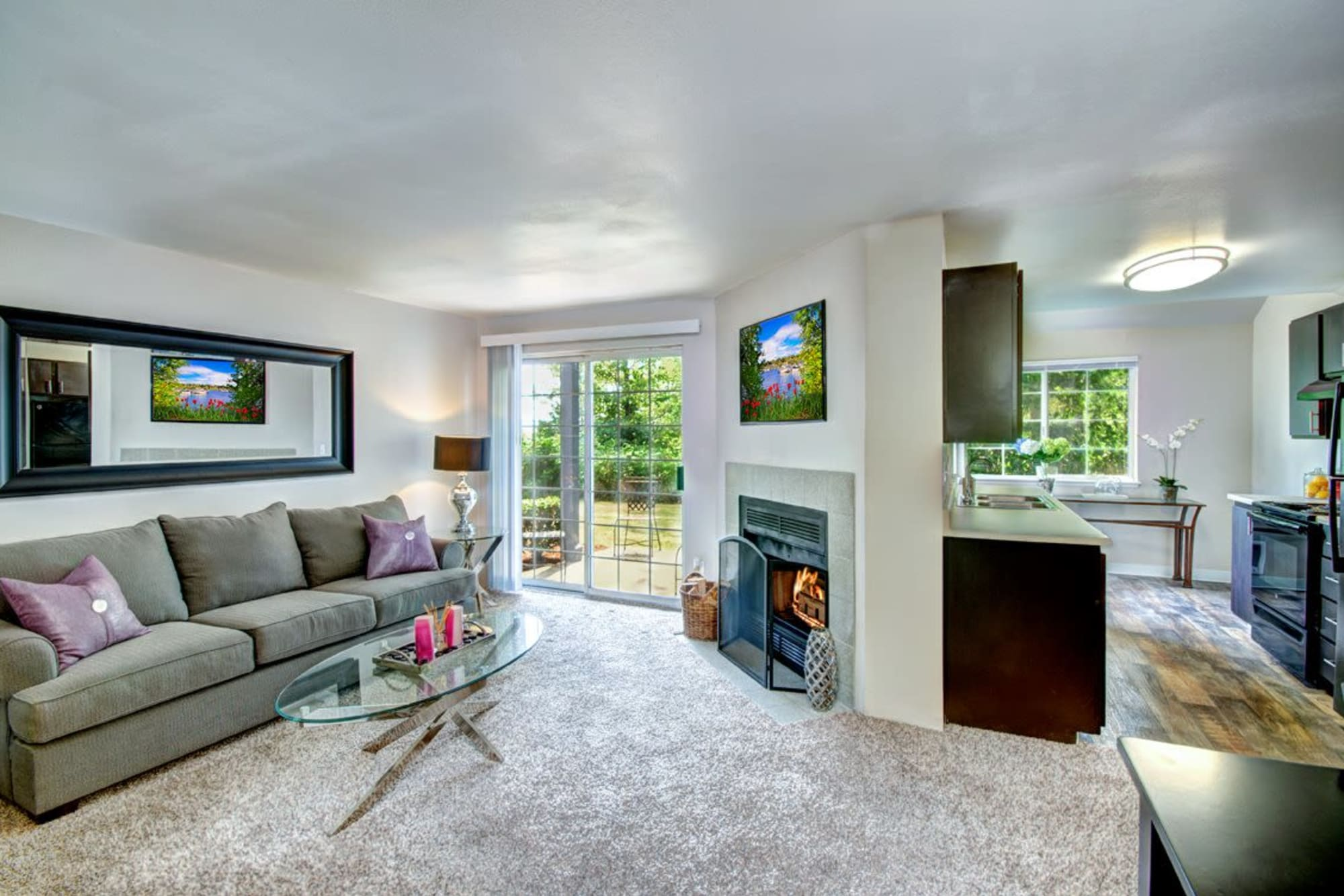 Large balcony doors in the living room in a model apartment at Wellington Apartment Homes in Silverdale, Washington