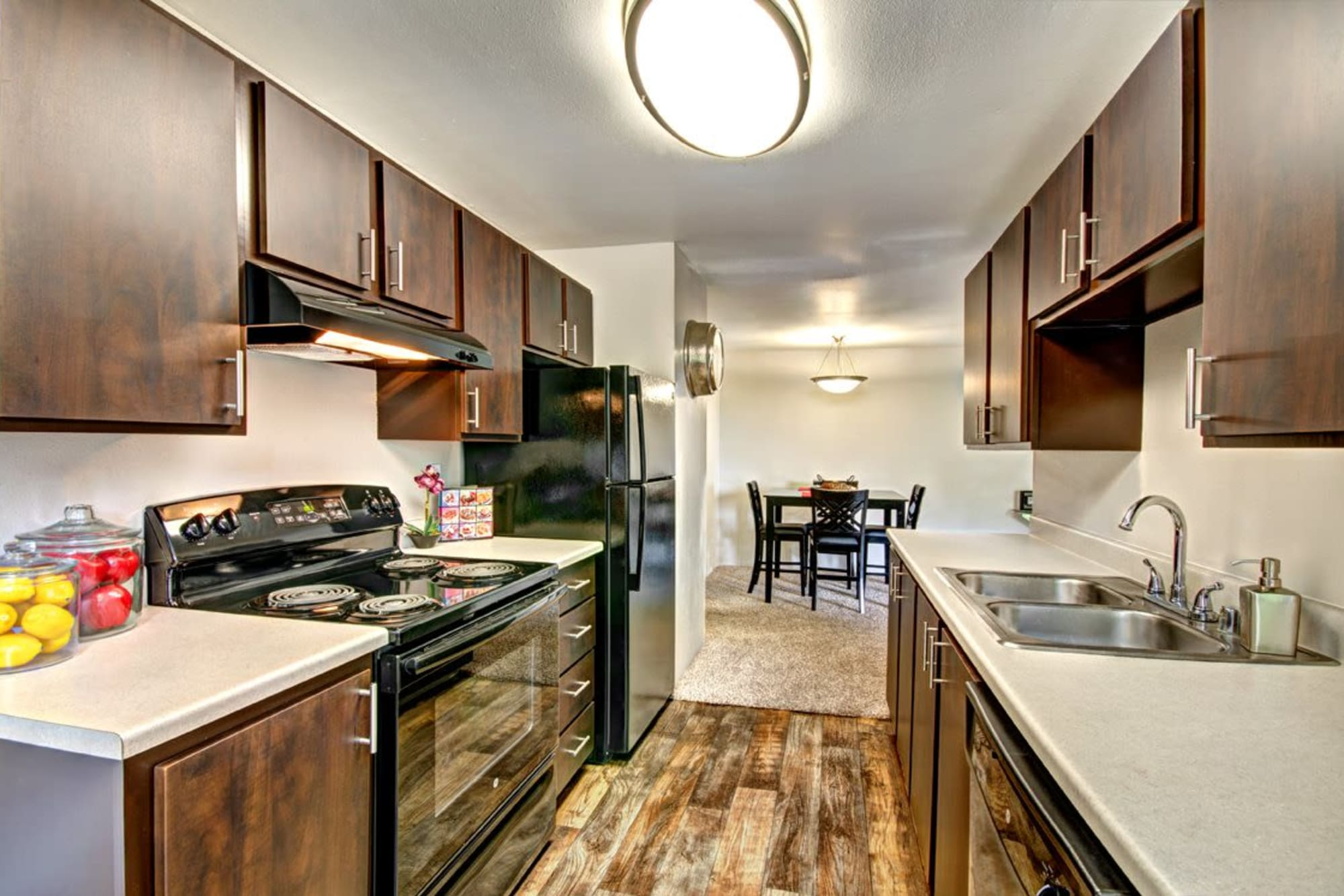 Hardwood-style floors in kitchens at Wellington Apartment Homes in Silverdale, Washington