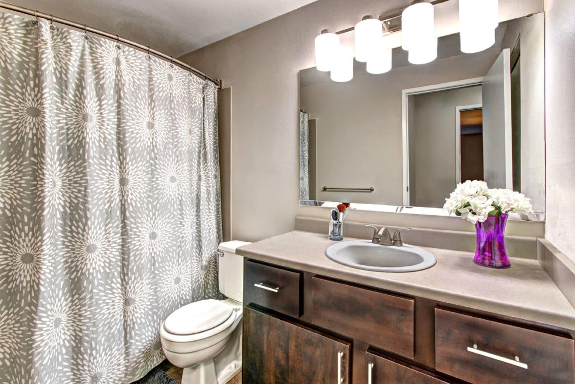 A stylishly modern bathroom at Wellington Apartment Homes in Silverdale, Washington