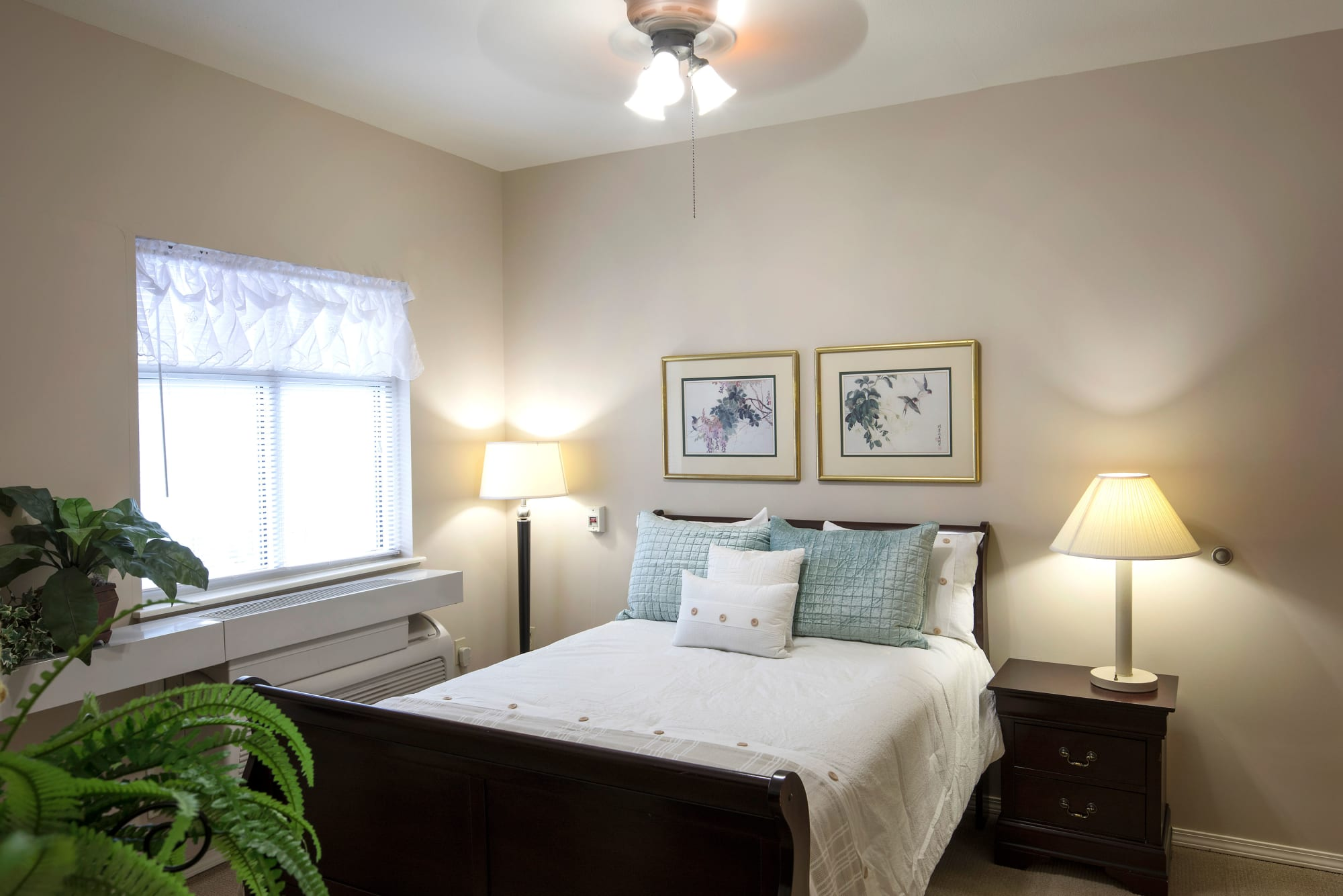 Bedroom in a senior apartment at Canoe Brook Assisted Living & Memory Care in Catoosa, Oklahoma
