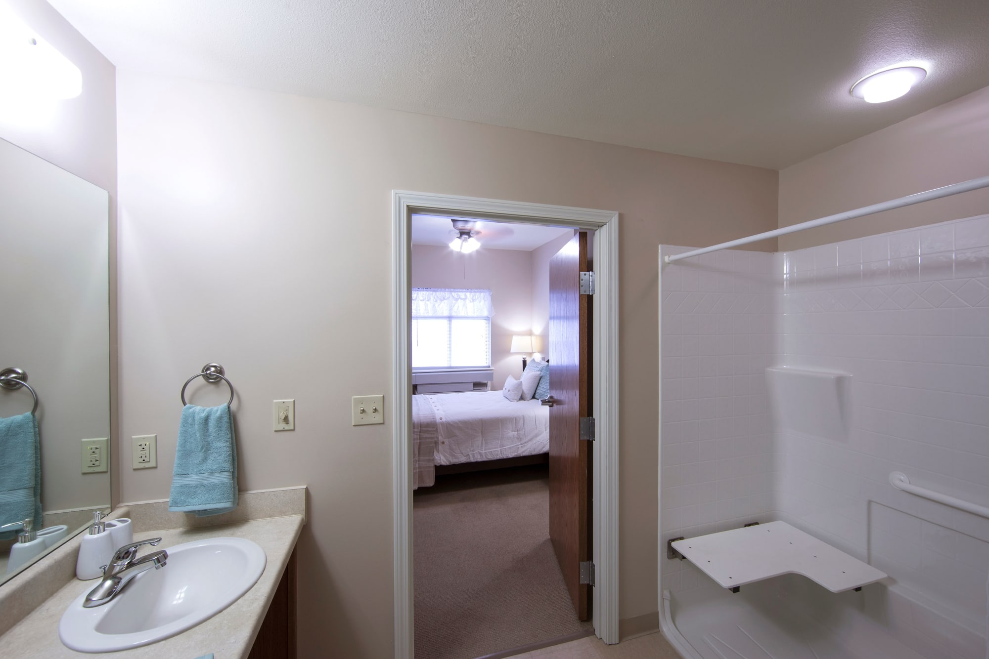 Walk-in shower in a bathroom at Canoe Brook Assisted Living & Memory Care in Catoosa, Oklahoma