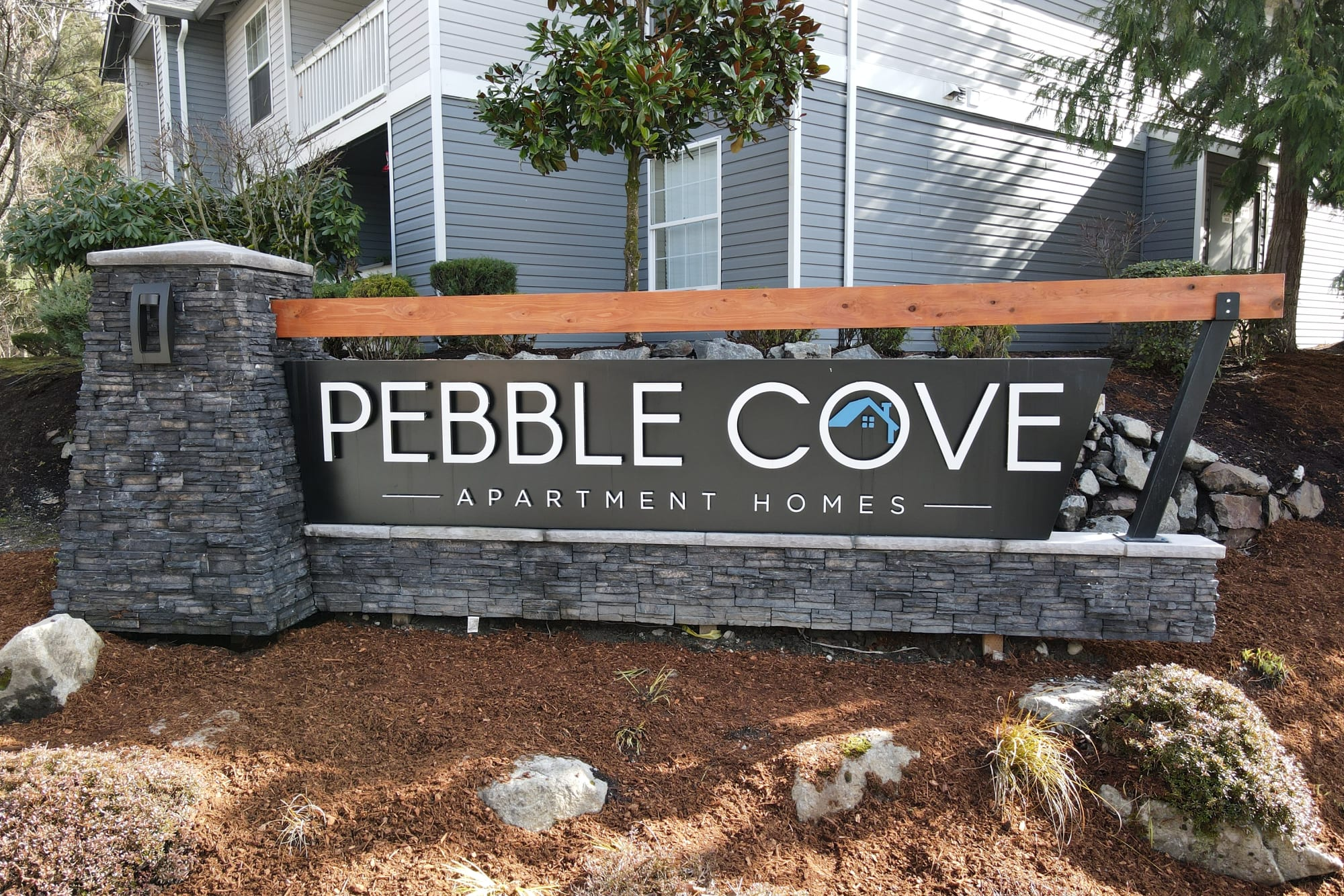 Monument sign at Pebble Cove Apartments in Renton, Washington