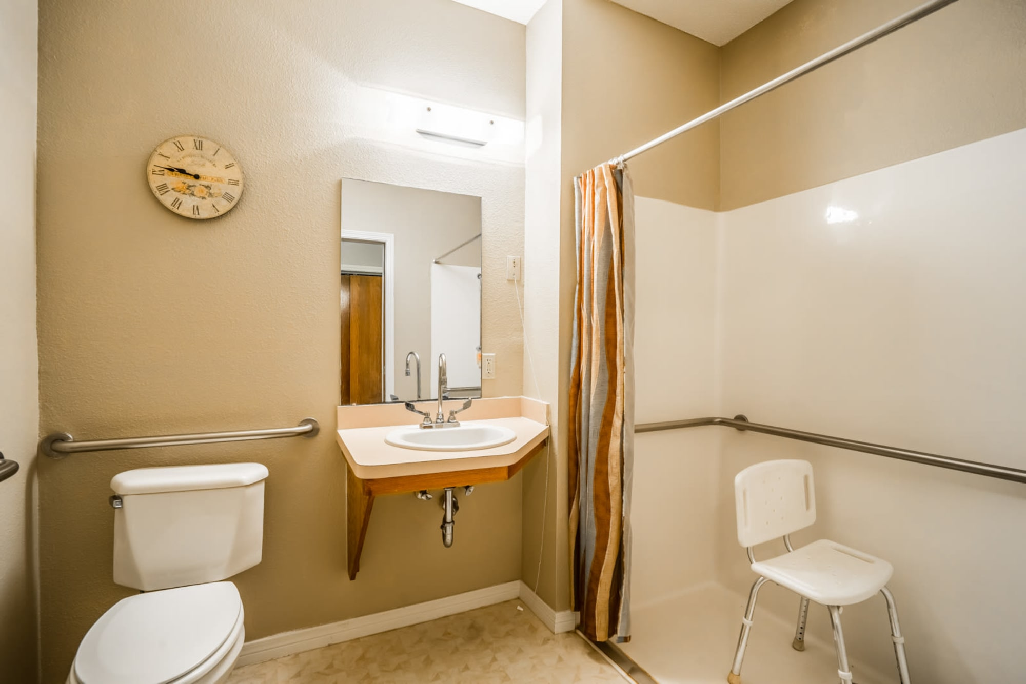 Easily mobile bathroom complete with chair shower at Saunders House in Wahoo, Nebraska