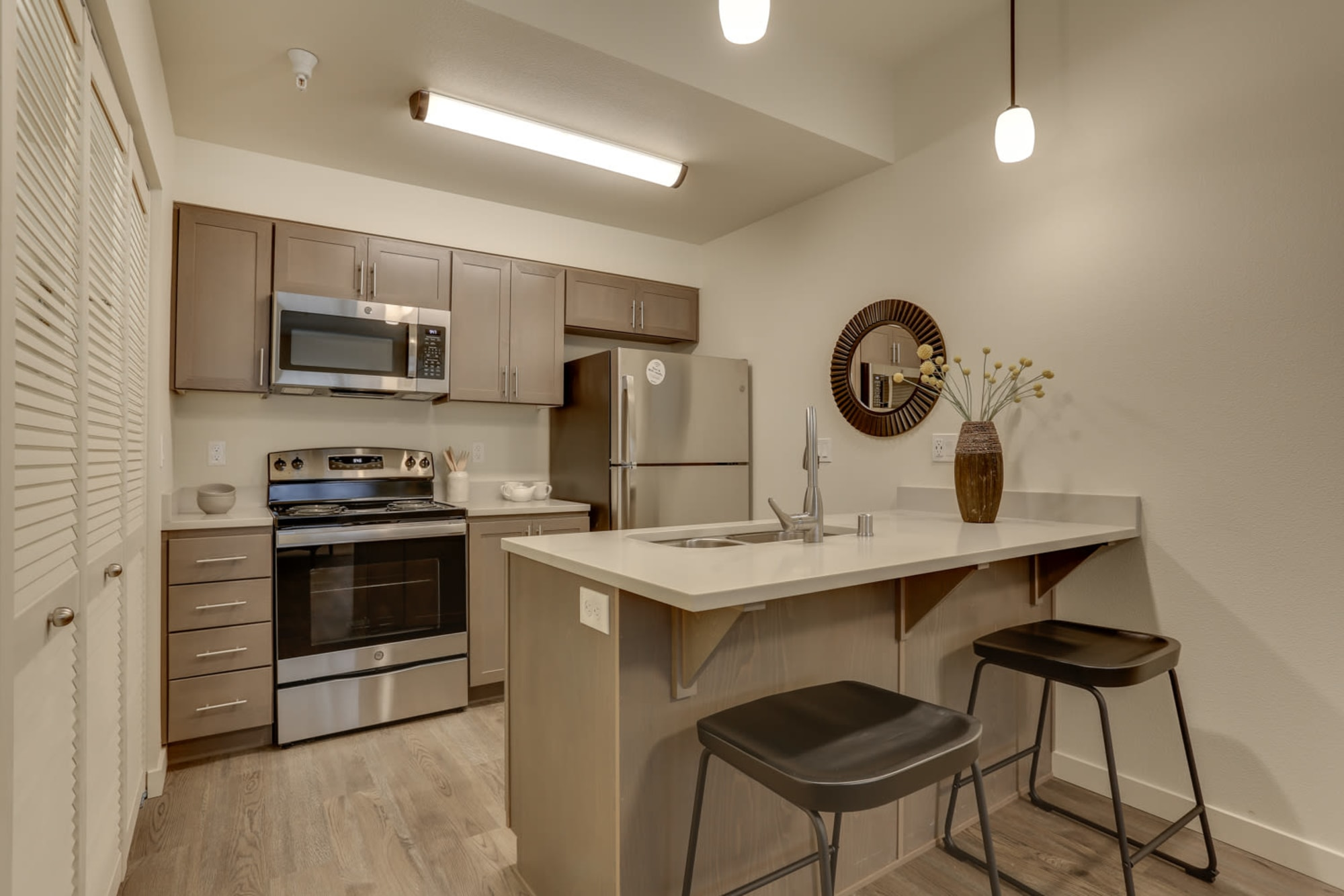 A kitchen with stainless appliances at Haven Hills in Vancouver, Washington