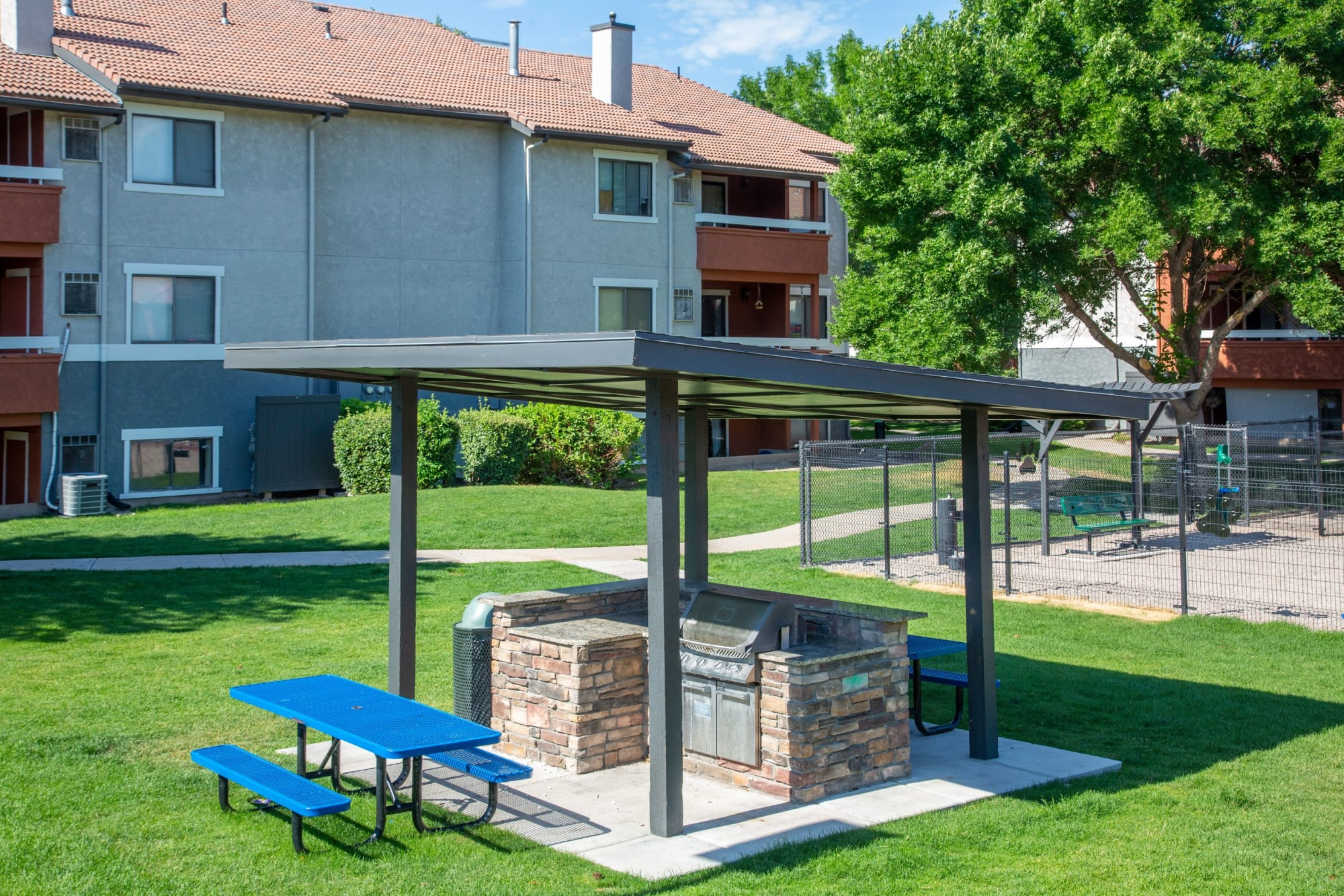 Covered BBQ and picnic area at Shadowbrook Apartments in West Valley City, Utah