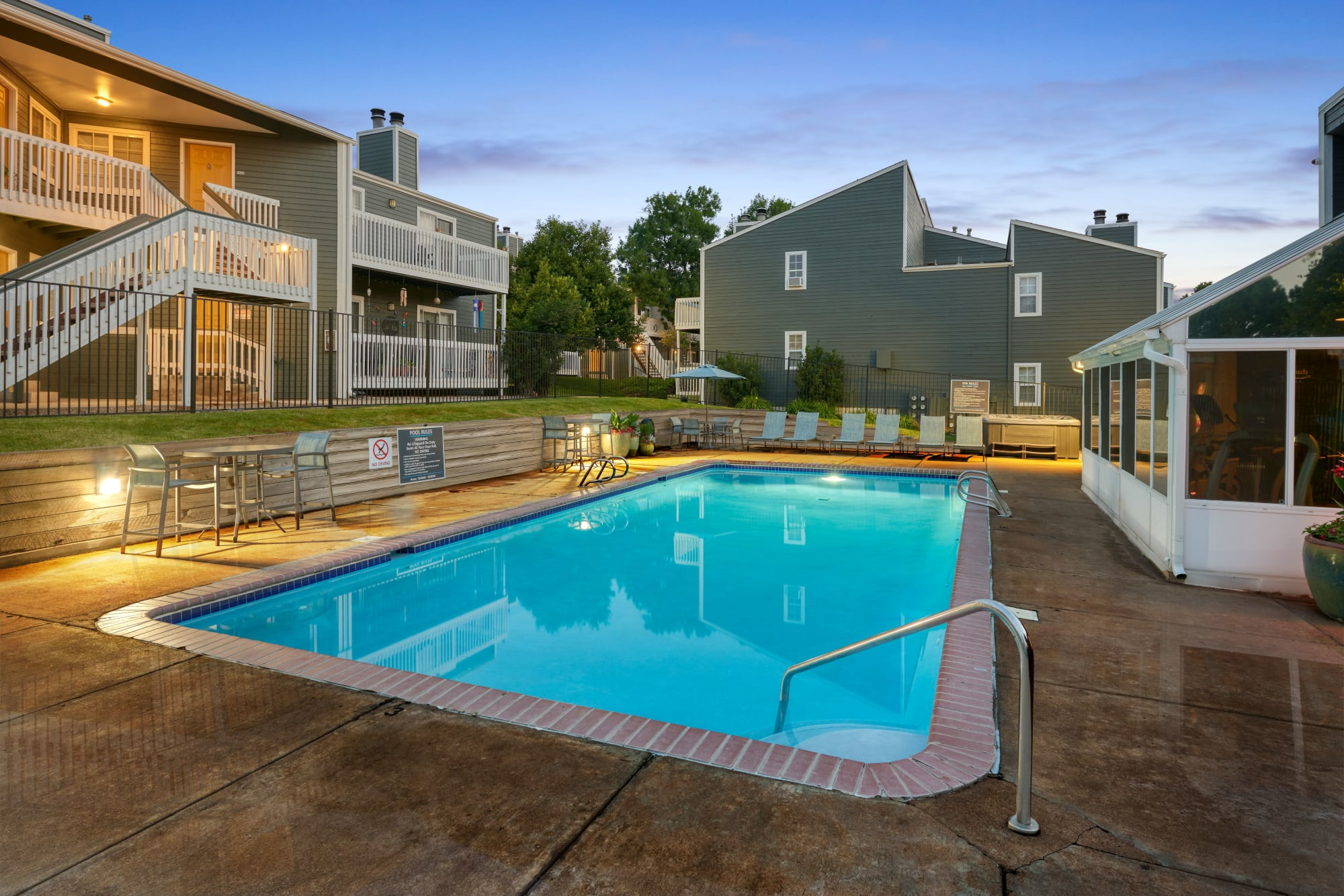 Relaxing lounge chairs by the pool at Bluesky Landing Apartments in Lakewood, Colorado