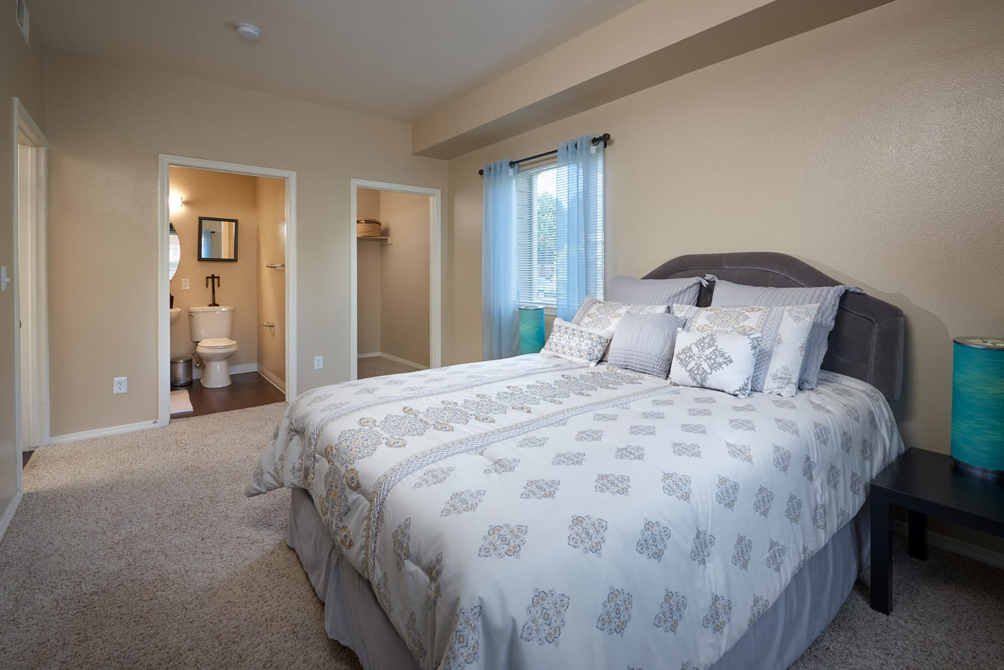 Master bedroom at Crossroads at City Center Apartments in Aurora, Colorado