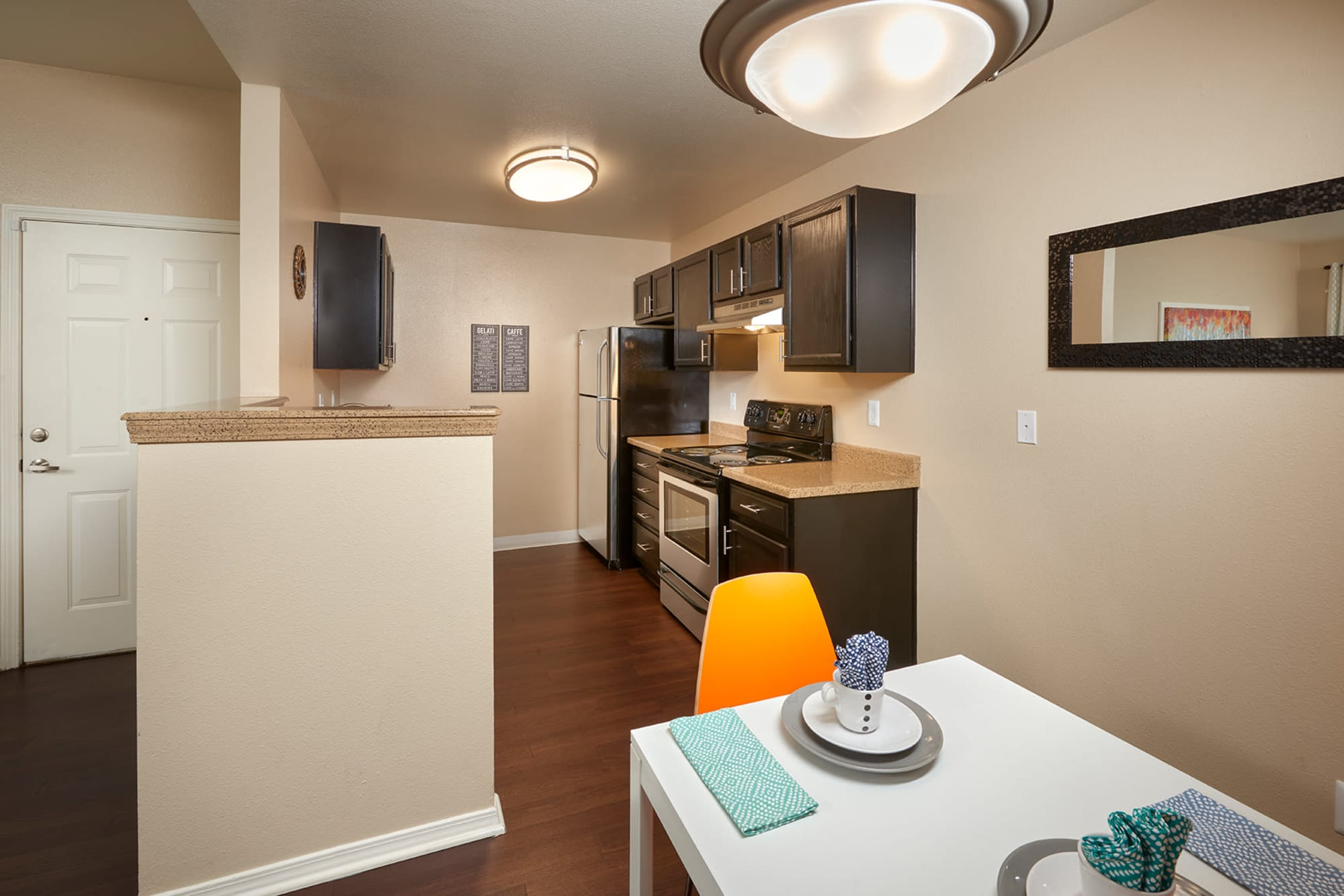 Kitchen and dining room at Crossroads at City Center Apartments in Aurora, Colorado