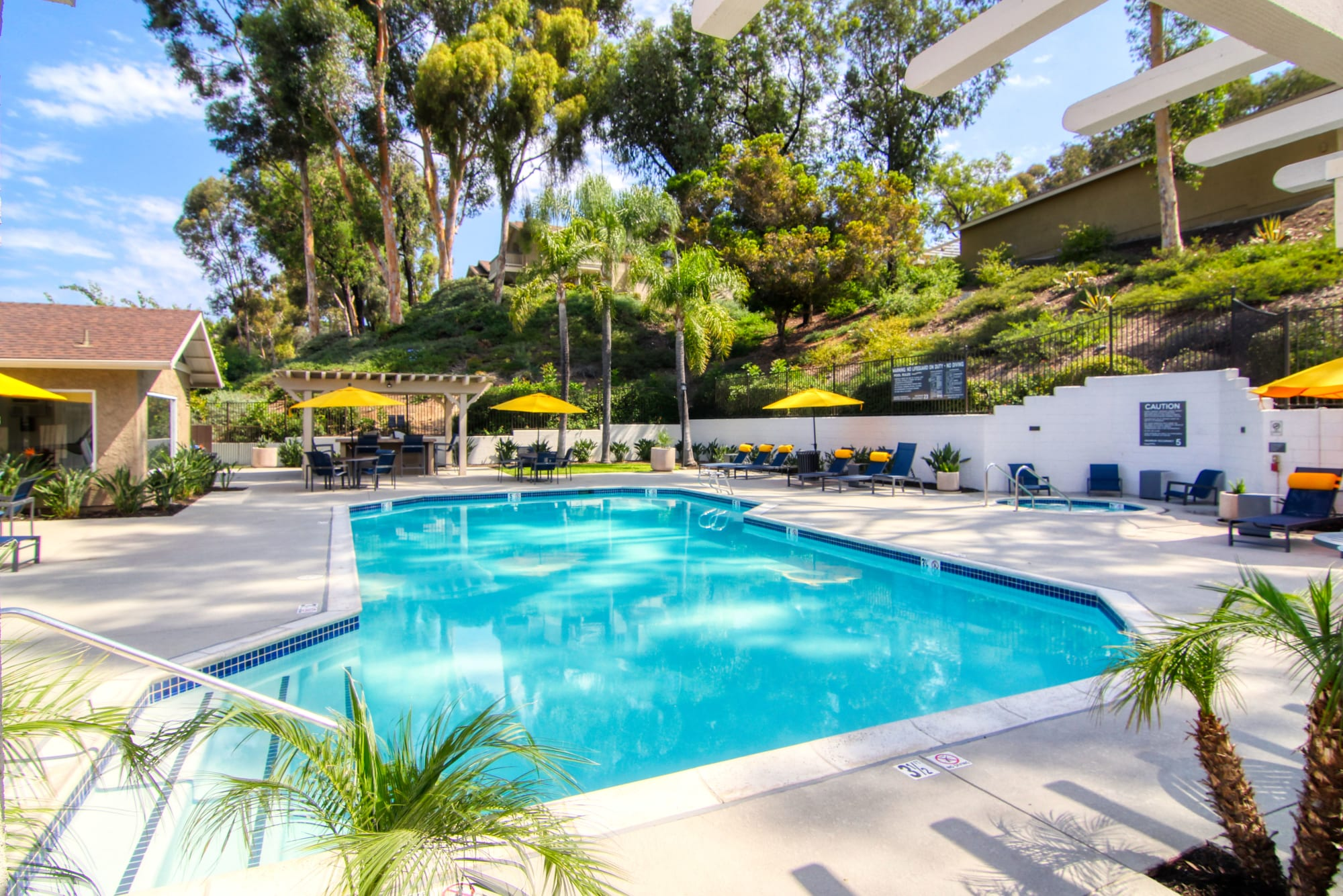 The pool at sunset at Lakeview Village Apartments in Spring Valley, California