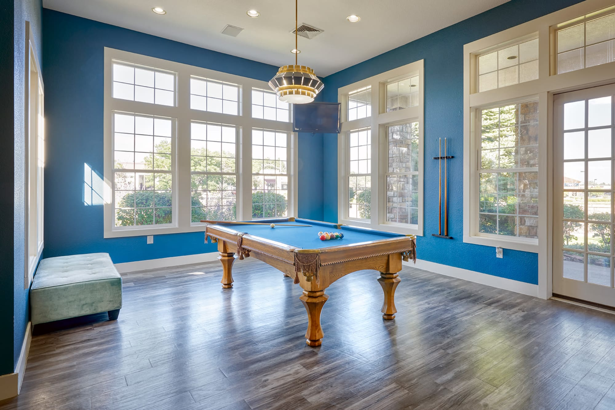 The clubhouse pool table on hardwood floors at Crestone Apartments in Aurora, Colorado